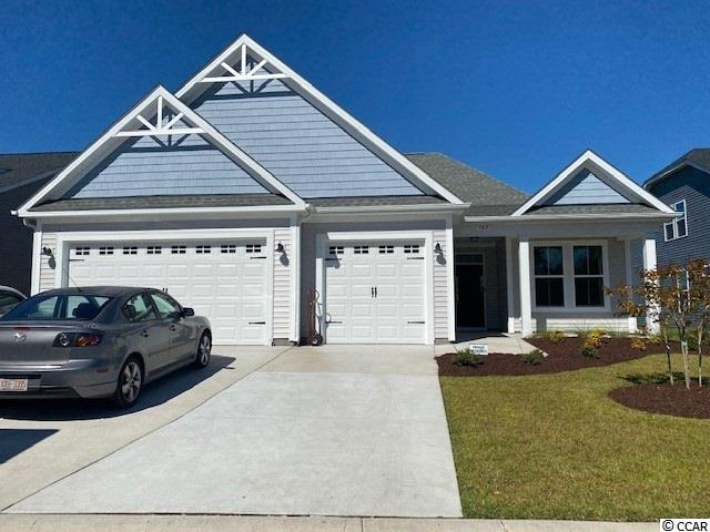 This 2,057 heated sq ft home offers a front and a back porch to enjoy the sea breeze of the South Carolina coast. This home has 3 bedrooms plus a study with glass French doors. Wide open concept for entertaining. There is a separate dining room with coffered ceiling and a breakfast room all open to the Kitchen and Great Room. Gourmet kitchen includes a gas stove and double wall ovens.  Master Bath features a tile walk in shower with a seat.  You can move in and have a place for your golf cart or classic car in the third car garage. This home is a must see today!! Located in the sought after Bridgewater community nestled in Little River just minutes from Cherry Grove Beach and North Myrtle Beach Shopping.   *Photos are from previously sold Coral Reef plan*