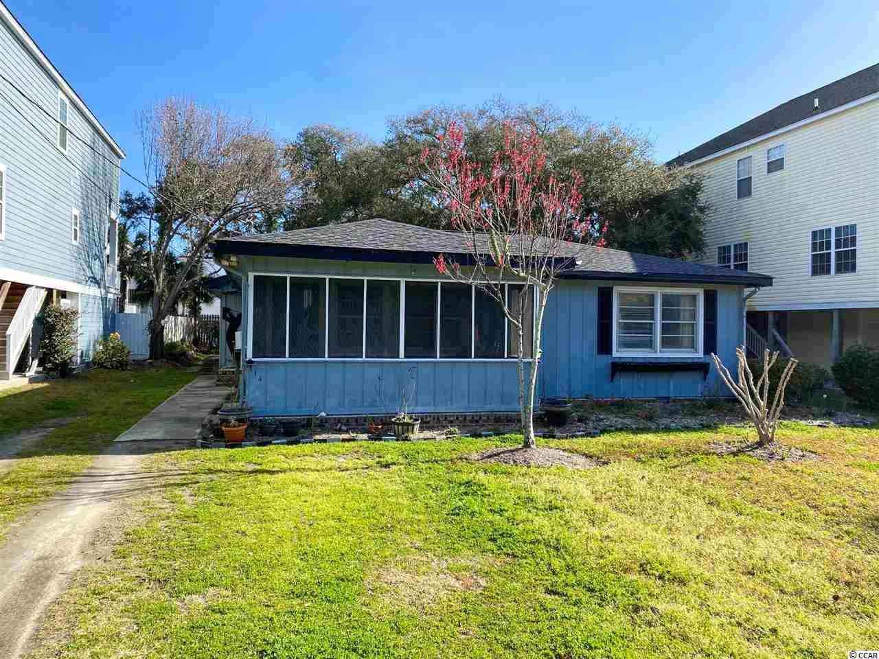 "Wonderful Location in The Town of Surfside Beach Just Steps to the Beach!  Home Needs TLC But Is A GREAT VALUE, ONLY 3 LOTS FROM THE BEACH!  The Lot Can Be Split And TWO VACATION HOMES BUILT... Or Remodel & Rent or Use...Or Build Your Dream Vacation Home!  Ask Agent For Survey For Current Lot AND Future Lots Split.  Home Is Configured As A ""Duplex"" With Two Kitchens And Separate Entrances.   Residents Of The Town Of Surfside Beach Enjoy TONS Of Community Services & Benefits Such As Free Beach Parking, Excellent Public Service From Police, Fire, Streets, Refuse Collection & Drainage Departments PLUS Many Community Events, Mosquito Spraying, Parks, Library, The Town Pier & Clean World-Class Beaches. Sq. Footage Estimated,Buyer To Verify."