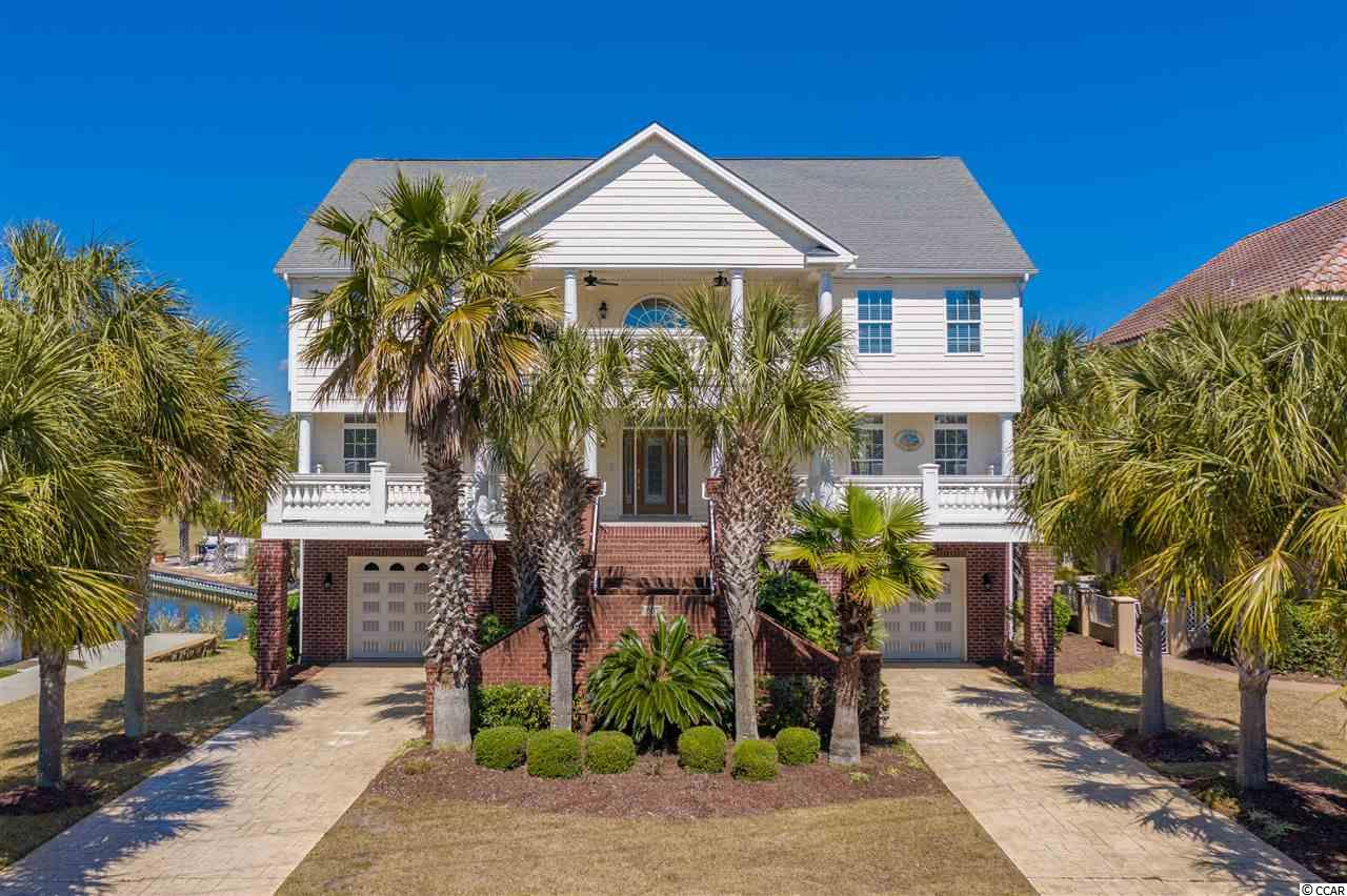 Truly STUNNING BEACH HOME! Located in the exclusive Seaside Plantation community of North Myrtle Beach, just 1 BLOCK FROM THE OCEAN! Unobstructed ocean view from your front balcony and a beautiful lake just off your back patio. This 7 bedroom, 4.5 bath home features: formal dining, MEDIA ROOM, dedicated office space, custom kitchen, 3 floors , an ELEVATOR, intricate architectural details, fireplace, gorgeous MASTER SUITE, tons of storage, and UPDATES galore! **Owner is including all of the flat screen TVs with the sale! Enjoy the clubhouse and pool after a long day or take the golf cart down to all the attractions on Main Street NMB, or go straight to the public beach access ! Beach living at its finest with great schools, golf, shopping and dining all around you AND a true sense of community. Call for a private tour today!