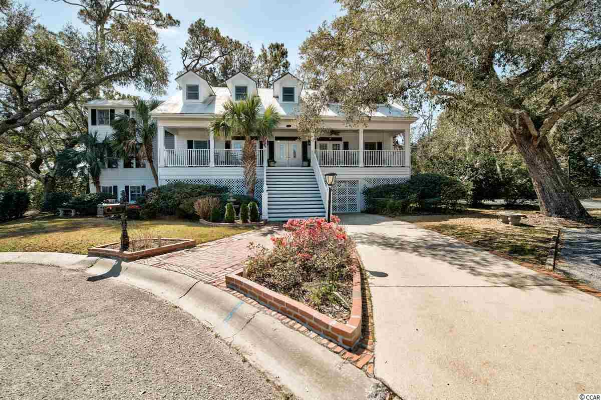 "Oak Lea is a hidden gem in the heart of Pawleys Island. This small gated community complete with a tennis court, pool and dock has much to offer. The house itself boasts spectacular views of the marsh and slight ocean views.  Amazing sunrises, fresh ocean breezes, and  late evening dips in the pool are just a small part of the southern charm found here. This is a uniquely designed home that has a large area for entertaining friends and family with many flex spaces so that you can easily make it fit your needs. It features a sunny Carolina Room, closed in porch with sliders, a large master bedroom with dressing room and a traditional Southern front porch complete with rockers and swing for year round enjoyment.  Below the main living space you will find a complete suite with multiple uses. Call it a man cave, recreational room, exercise room, billiards room or a fabulous mother-in-law suite. There is an elevator for easy access to all three floors and lots of storage space. You may never want to leave the comfort of this cozy mini-resort residence. The location is ideal with nearby beaches, rivers, parks, historical towns, shopping and much more. Come see why so many are choosing to live in  ""Arrogantly Shabby"" Pawleys Island."