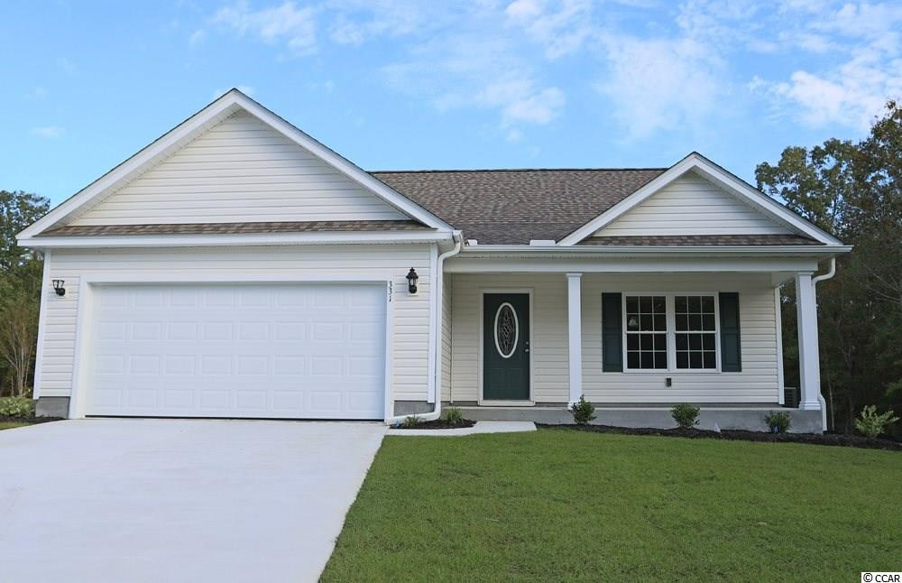 """Beautiful Busbee Plan in The New Woodland Lakes Community in The City of Conway, SC. Plan offers all of the right features and benefits.  Features include but are not limited to 3 Bedrooms 2 Baths, 2 Car Garage, Granite Countertops in Kitchen,Great Open Floor Plan, Vaulted and Trayed Ceilings, 2 Ceiling Fans, Plant Shelf, and Vinyl Windows, Plans also include Separate 10x14 Concrete Patio, Sidewalks to Front Entry and Driveway. All of the Homes in Woodland Lakes Community come standard with the luxury of a Tankless Hot Water Heater, Gas Heat, Gas Stove and Oven. These new Homes also include 36"""" Profiled Kitchen Cabinets with Top Molding Trim and Door Knobs, Stainless Steel Appliances, Kitchen Pantry, Linen Closet, Completely Trimmed and Painted Garage with Drop Down Storage Access, which is Floored for your convenience, and Electronic Garage Door with Remote Openers. """"Low E"""" Energy Efficient Windows, Upgraded Insulation Package, Landscaped, Sodded Yard, and so much more.  All of the homes in Woodland Lakes are built with a """"Maintenance Free"""" Lifestyle in mind. Woodland Lakes is South Conway's Newest Community conveniently located near Shopping, Medical Offices and Hospitals, Restaurants,  and Schools. The Builder DOES ALLOW CUSTOM HOME CHANGES ON PRESALE HOMES!  Call or visit us online today and find out why This Builder is The Areas Premier Local Builder! Other Floor Plans, Inventory Homes and Custom Plans are Available. Call the Onsite Model for New Homes Availability and to make an Appointment to see Woodland Lakes."""