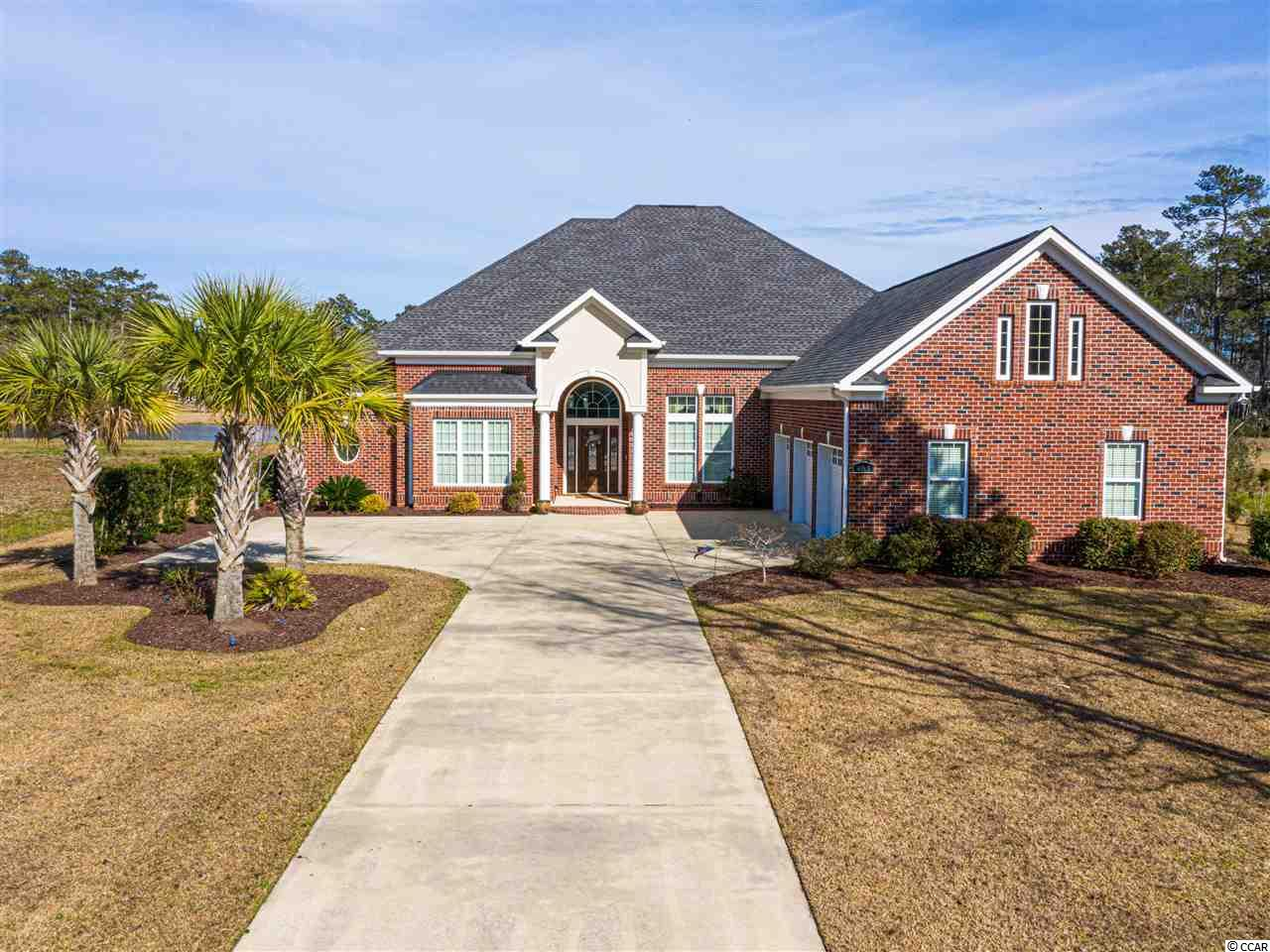 Stunning ALL BRICK RANCH HOME in Cypress River Plantation, A Prestigious Gated Waterway Community Known For Stunning Custom Homes & First Class Amenities. This Showplace & Entertainer's Delight Is Perfectly Positioned On A 1 Acre Lot With Large Backyard & BREATHTAKING LAKE VIEWS.  Features Include Gas Fireplace, 5-Burner Cook Top and Outside Grill Hookup. In The Cook's Kitchen You Will Find Custom Cabinets with Tons of Storage, Walk-in Pantry, Built-in Convection Oven and Microwave. Soaring Ceilings, with Trays in Kitchen, Dining Area, and Foyer.  The Well Appointed Master Suite Has Access to Outside Covered Lanai Overlooking the Lake. Custom Built-in Bookcases and Crown Molding throughout.  Large Walk-up Attic With Potential to Convert into Additional Living Space. Community Boat Launch and Day Docks.  This Home Was CUSTOM BUILT BY RESPECTED LOCAL BUILDER.  Cypress River Plantation Is A Gated Community That Features 24/7 Security, Clubhouse, Resort-Style Saltwater Pool, Basketball Court, Tennis Court, Sidewalks, Private Access To The ICW With Boat Launch, & Boat/RV Storage.  Conveniently located just Minutes from the Beach, Marshwalk, Shopping, Dining, Medical and Golf. Measurements & Sq. Ft. Approximate.