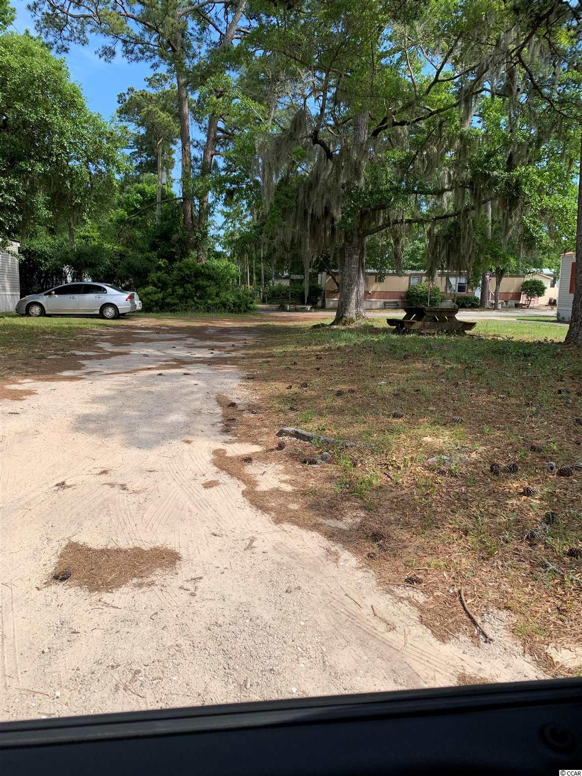 Nice lot in The Grove. You can have a single wide, doublewide, modular or stick built. A short golf cart ride to Cherry Grove Beach, grocery stores, shopping and more. 3 blocks away from the ICW.