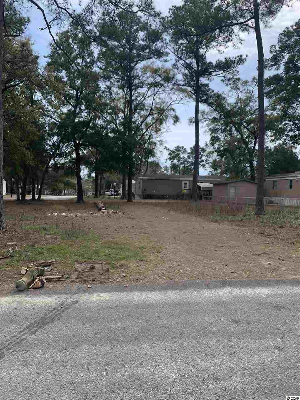 Nice lot in the Grove for Single wide, Doublewide, Modular or Stick built. Just a short golf cart ride away from The Cherry Grove Beach, Grocery store, Restaurants, Shopping centers and more. 3 blocks away from the ICW.