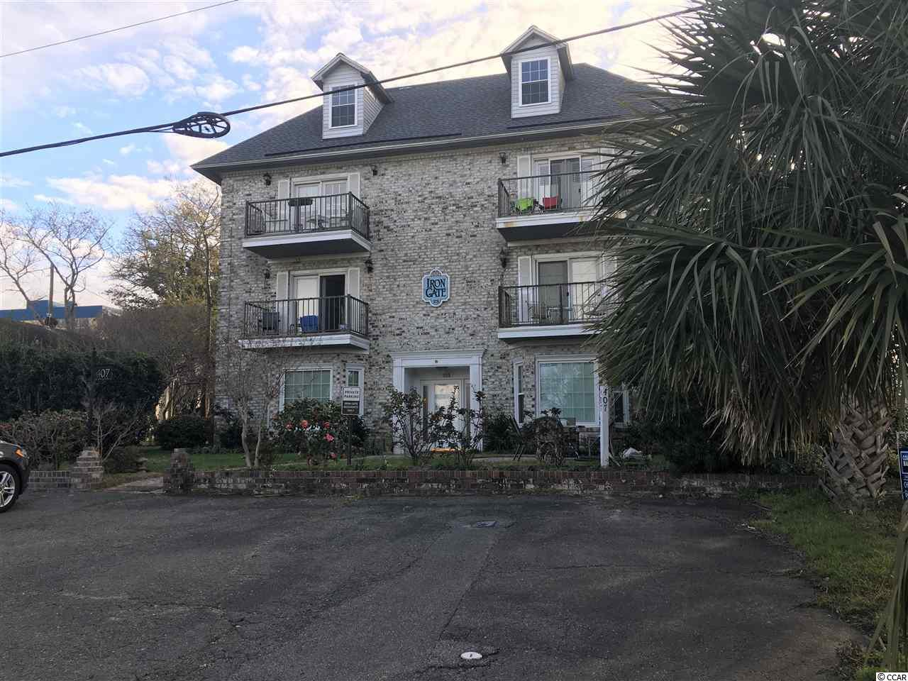 Located in the Iron Gate complex. Iron Gate is 1 block from the sandy shores of the Atlantic ocean off of 23rd Ave N. in Myrtle Beach. 2 bedrooms,  2 bath unit. This is an excellent opportunity. The unit has been updated and offers solid surface countertops, stainless steel appliances, tile flooring, laundry room. Check this out today! Keep as an annual rental or convert to short term! You have lots of options!  Square footage is approximate and not guaranteed.  Buyer is responsible for verification.