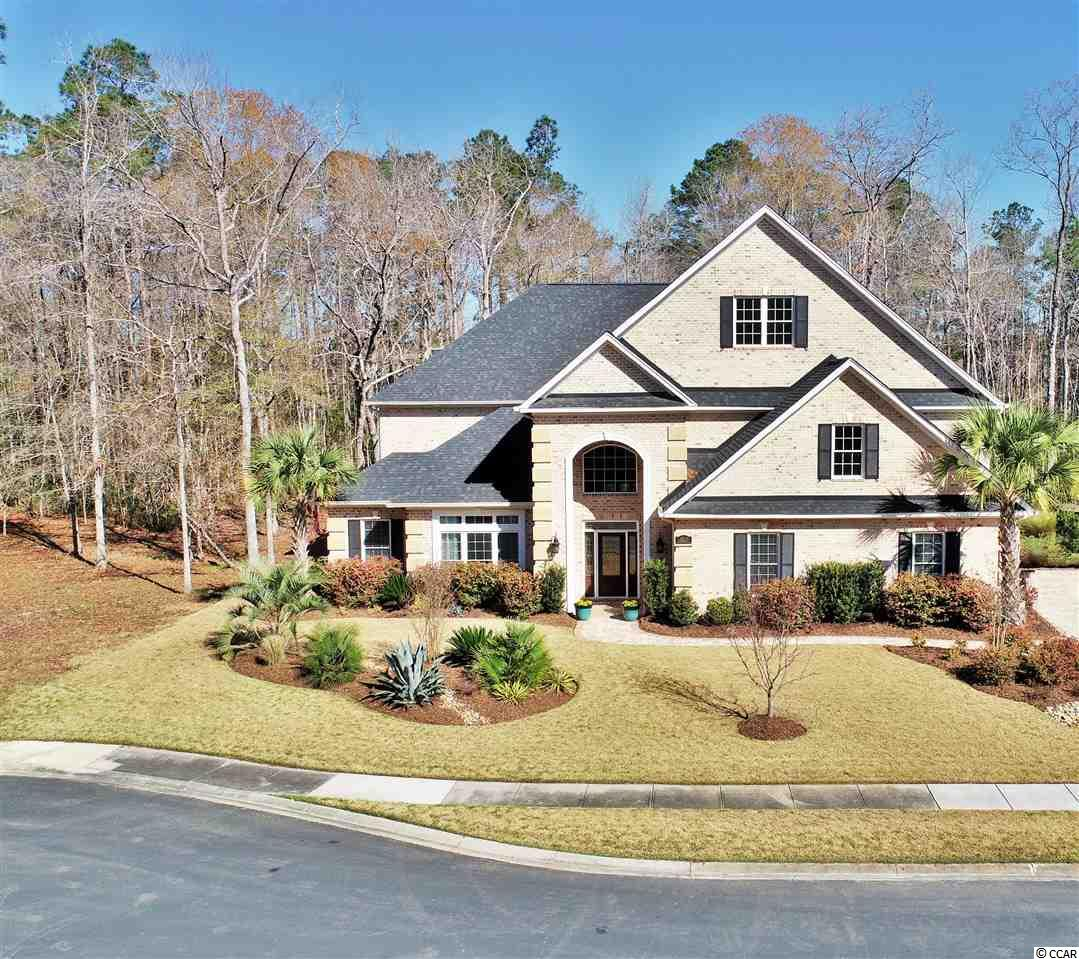 """From the moment you enter the gates of Cypress River Plantation you will realize you have found home ! Stately and refined with the feel of comfort is how you will describe at 8020 McSweeney Court. Located on a cul-de-sac street and situated on a generous 1.16 acre lot, this one will undoubtedly please the most discriminating buyer. With over 5,000 square feet under roof, private porches / balconies overlooking your wooded back yard, soaring ceilings, and a plethora of upgrades there isn't much not to love. The open kitchen boasts granite counters, back-splash, pot-filler, 42"""" custom grade cabinetry, stainless appliances with gas range, and an over-sized pantry closet area has been """"reinforced"""" to provide a """"panic room""""/ safe environment. The family room features a remote operated gas fireplace, 16 ft multi glass panel sliders opening to outside Lanai and entertainment area. You will be amazed by the incredible outdoor living available in this home. Among the long list of features, the outdoor lanai area hosts an outdoor kitchen, remote control blinds, and so much more. Additionally, if you enjoy guests or just need the extra room; The 2nd floor houses a full guest suite with a private bath and direct access to a wrap around balcony that takes advantage of natural views you will soon call your own. Additional Upgrades and noteworthy features include: Reverse Osmosis whole house water system. Coffered / Tray / Cathedral ceilings throughout various rooms,  interior / exterior sound system, and  dimming LED lighting throughout. ASK YOUR REALTOR FOR A FULL LIST OF UPGRADES :::: Cypress River Plantation is a gated community in Myrtle Beach on the Waterway offering it's residents Boat Storage, Day Docks, Boat Landing, Pool, Tennis, and More."""