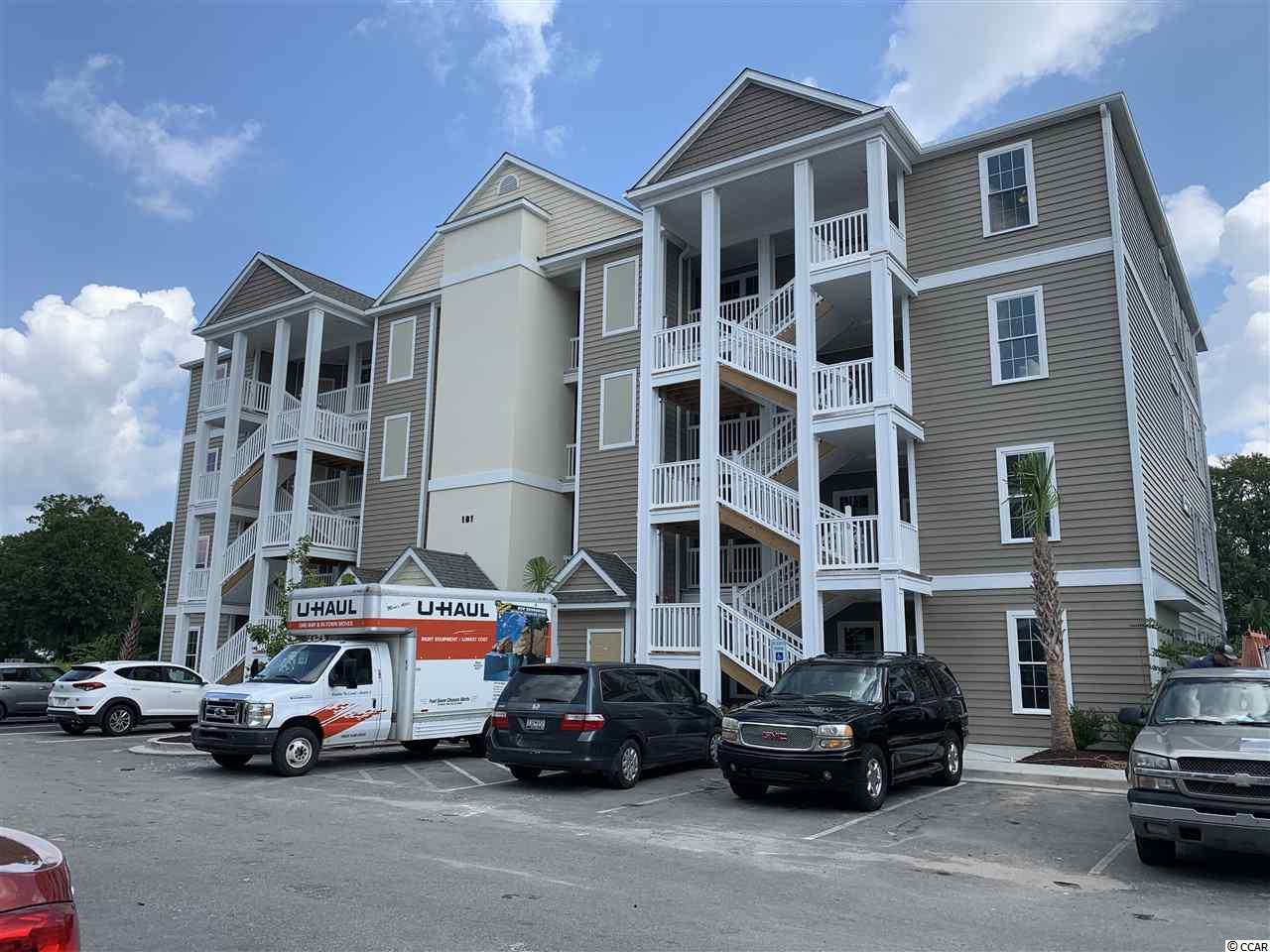 Located in one of the most successful condo developments in the Myrtle Beach area, this top floor end unit is a 3 bedroom 2 bathroom beautiful condo in the very popular Queens Harbour! Building has an oversized ELEVATOR to all floors, outside storage, split bedroom floor plans with entry to the Master Suite from the Family Room, 9' smooth ceilings and a screen porch. The location is superb with shopping, dining and recreation steps away. The amenity package includes a resort style swimming pool with a club house and conveniently located picnic areas with grills.