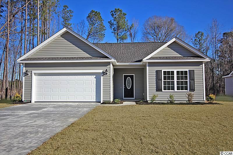 "Beautiful Oak II Plan in The New Woodland Lakes Community in The City of Conway, SC. Woodland Lakes is a Natural Gas Community located in Conway, South Conway just minutes to Historical Downtown Conway, Coastal Carolina University, and Conway Medical Center. Plan offers all of the right features and benefits.  Features include but are not limited to 3 Bedrooms 2 Baths, 2 Car Garage, Great Open Floor Plan, Vaulted and Trayed Ceilings, 2 Ceiling Fans, Plant Shelf, and Vinyl Windows, Plans also include Separate 10x14 Concrete Patio, Sidewalks to Front Entry and Driveway. All of the Homes in Woodland Lakes Community come standard with the luxury of a Tankless Hot Water Heater, Gas Heat, Gas Stove and Oven. These new Homes also include 36"" Profiled Kitchen Cabinets with Top Molding Trim and Door Knobs, Stainless Steel Appliances, Kitchen Pantry, Linen Closet, Completely Trimmed and Painted Garage with Drop Down Storage Access, which is Floored for your convenience, and Electronic Garage Door with Remote Openers. ""Low E"" Energy Efficient Windows, Upgraded Insulation Package, Landscaped, Sodded Yard, and so much more.  All of the homes in Woodland Lakes are built with a ""Maintenance Free"" Lifestyle in mind. Woodland Lakes is South Conway's Newest Community conveniently located near Shopping, Medical Offices and Hospitals, Restaurants, and Schools. The Builder DOES ALLOW CUSTOM HOME CHANGES!  Call or visit us online today and find out why This Builder is The Areas Premier Local Builder! Other Floor Plans, Inventory Homes, and Custom Plans are Available. Call the Onsite Model for New Homes Availability and to make an Appointment to see Woodland Lakes. Some lots have additional Premiums."