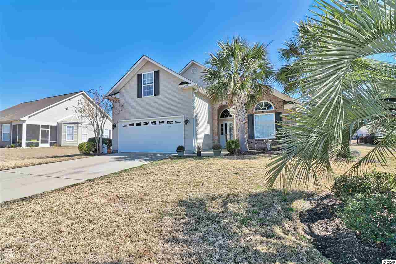 Come see this beautiful home located in popular gated community of Surfside Beach Club. You will love this spacious 2-story traditional style home with convenient floor plan and beautiful lake views. This 3-bedroom, 2.5-bathroom home has a 2-car garage—giving you 2350 sq. ft. of spacious elegance, two dining areas, sun room, high ceilings, 1st floor master bedroom with a large master bath with direct access to the laundry room, and additional bedrooms and bath upstairs. All of this situated in a convenient, friendly neighborhood with outstanding schools, only minutes away from shopping, entertainment, restaurants, and the beach.