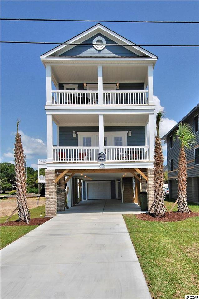 """Take advantage of this opportunity to own a little piece of paradise in sunny, family friendly Surfside Beach.  This well maintained 5 bedroom, 5 1/2 bath beach home with a private heated pool could be yours!  """"My 401 Cay"""" boasts an open floor plan with neutral tones throughout, beautiful ocean views, an enclosed outdoor shower and beach access directly across the street. Use it just for you & your family, keep it on the rental program and continue as a great investment - choice is yours! Don't miss out on this great buy with no HOA fees! All info deemed reliable but not guaranteed. Buyer is responsible for verification."""