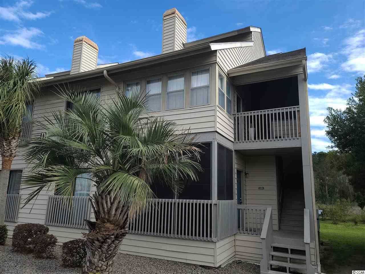 Location, Location, Location.  Be the proud owner of this 4 bedroom condo in the area of Surfside Beach, the family beach.  This is a short bike ride or walk down to the beach and the pier area of Surfside.  This unique unit has 4 bedrooms and a wood burning fireplace. There have been so many upgrades done to this unit, you will just need to see it.   The front porch has been closed to add an additional room to the unit which can be used as an office or 4 seasons room.  The living room is open with a nice wood burning fireplace to enjoy on those chilly winter nights.  The kitchen has been remodeled with a breakfast bar and a beautiful copper ceiling fa-sad. The two back porches have been updated with new roofs, screening and ez porch type windows for more outdoor use of the area in your home.  The porches have a wonderful view of the pond, so you can sit on the porch in the mornings with your coffee and enjoy the view and the sounds of the wildlife.  In the evenings, you could use the area to relax and unwind.  The upstairs has a common living area for the 2 bedrooms up there with one of the rooms having a loft.  Perfect family beach retreat.  The community has its own pool and is walking distance to the grocery store, shopping and restaurants.  Don't let this great place pass you by.  Owner will also consider partial owner financing. Call today to schedule your showing.