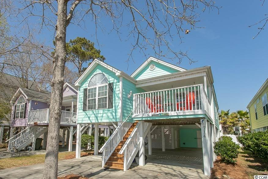 "Looking for a charming ""island style"" raised beach house in a desirable area of Surfside Beach? This 3 Bedroom, 2 Bath home is the perfect fit! This home is just 4 blocks to the Atlantic Ocean & just a short walk or golf cart ride to the beach! Spacious and Open floor plan with plenty of options for relaxing or entertaining guests. Soak in the sun and ocean breeze from the front porch or enjoy privacy from the fenced in backyard. Hot Tub is located underneath the house with lots of privacy. Storage under house is large enough to store a golf cart or motorcycle. Home is currently used as a second home/non rental and has been well-maintained. This quiet community is also a close distance to plenty of great restaurants and shops. Enjoy the freedom of no HOA! Make this home your own personal paradise - Schedule your private showing today!  All square footage is approximate and is not guaranteed. Buyer is responsible for verification of measurements."