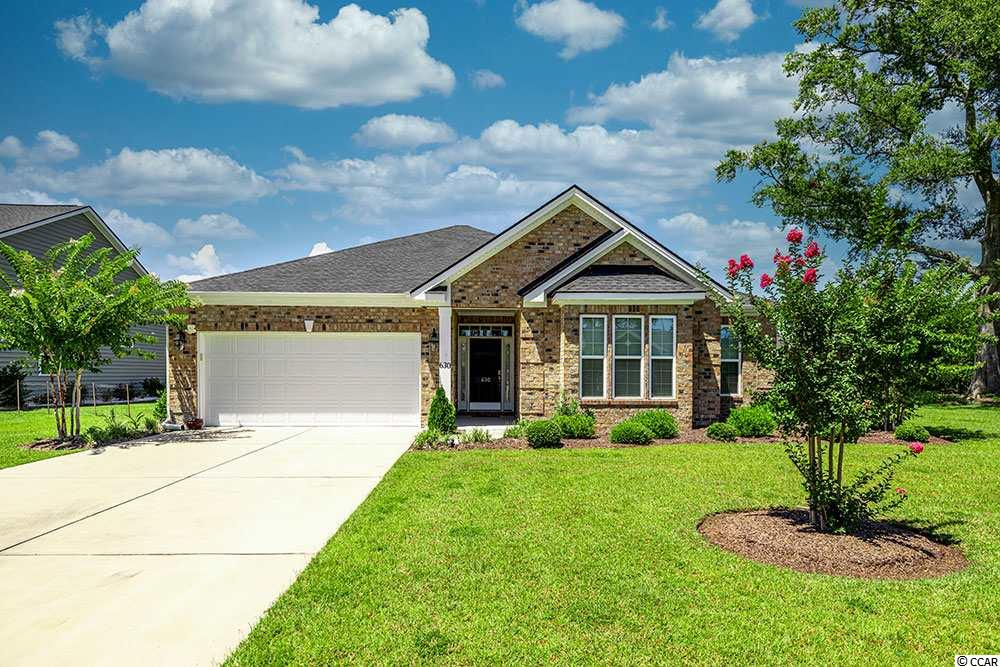 "Welcome home to this beautiful 3 bedroom 2.5 bath natural gas home in The Brookfield Estates community of Murrells Inlet!  This sought after ""Magnolia"" model home features an open/split floor-plan with hardwood floors flowing throughout the dining room, kitchen, living room and Carolina room areas.  The spacious kitchen is a cook's delight and features granite counter tops, 42 inch cabinetry with crown molding, roll out shelving, stainless steel appliances, work island, built in desk and a large walk in pantry!  A spacious living room that features a gas fireplace leads to the bright and airy Carolina room!  Enjoy the fresh morning air from the 10x18 screened porch just off the Carolina room!   The large master bedroom of the home features dual walk in closets, tray ceiling with crown molding and sealing fan!  The master bathroom features double vanitys/sinks, 20 inch ceramic tiles, A large soaking tub and walk in shower!  Other features of this home include rain bird sprinkler system, tankless hot water heater, 2 inch faux wood blinds, rain gutters with down spouts, a 2 car garage, brushed nickle fixtures, pulls and door handles.  Community amenities include  features a large outdoor pool, covered picnic area and playground.  Brookfield estates is located in the heart of Murrells Inlet and is just a short drive from area beaches, shopping entertainment and the very popular Murrells Inlet Marsh Walk!  Do not miss your chance to own this amazing home, call today to set up your showing!"