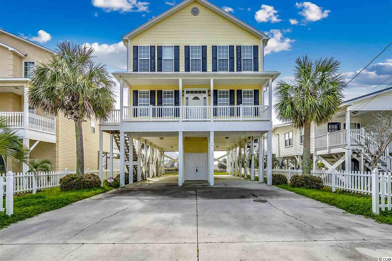 Fantastic fully turnkey, raised beach home with a waterfront location!  Unique UNOBSTRUCTED FULL OCEAN VIEWS from the back decks, but located directly on the marsh.  Traditional low country styling and located in the ever popular section of Cherry Grove Beach.  This better than new home was built in 2006 and has been used very sparingly by the owners as a second home get away.  This home will offer many features that most in the area do not simply due to it's newer age.  High ceilings, energy efficiency, spacious floor plan, large bathrooms, and tons of closet storage space.  While this home is in a prime Cherry Grove channel location it does NOT have the associated dredging assessment.  Wonderfully suited to be a family beach get away or a luxury vacation rental.  The home is tucked away at the quiet and private end of Cherry Grove and is just a short walk or golf cart ride to the beach.  Inside you will find an open living, kitchen, and dining area with two bedrooms on the main floor and full bath.  Tons of light flow into the home and the rear deck access offers extraordinary views of the ocean and marsh.  Double decks on the rear span the full width of the house and offer tons of space for outdoor living.  Hardwood plank flooring in a warm dark honey color complete the main living spaces and continue through the upstairs foyer.  Bedrooms are carpeted for a cozy feel.  The kitchen is the perfect gathering space for a large group with plentiful semi-custom cabinetry, granite countertops and stainless appliances.    Upstairs a beautiful owners suite has everything you could need for relaxation.  Rear deck access and spacious master bath complete with garden tub and walk in shower.  A full wet bar with wine fridge, sink, microwave and cabinetry offers a luxury feel.  Two additional upstairs guest bedrooms complete the five bedroom plan and also have large en suite baths.   A large walk in laundry closet with washer and dryer is located on the second floor as well.  Most importantly, the property comes turnkey!  All furnishings, appliances and decor will convey with the sale of this home.  Another tremendous value; the owners replaced both HVAC systems for coastal efficiency units 2018.  The exterior of the property affords the owner low maintenance with an all vinyl exterior, composite decking, and vinyl handrails.  Fully raised on pilings and flood compliant, owners will have an extremely low flood insurance premium.  The ground floor has a large enclosed storage space for all of your beach toys.   If you desire a private pool, there is just enough room to add one and make this your own personal oasis.  Don't miss this jewel of a home that's ready for you to enjoy as a beach getaway or a luxury rental investment!  All information deemed reliable, buyer responsible for all verifications.