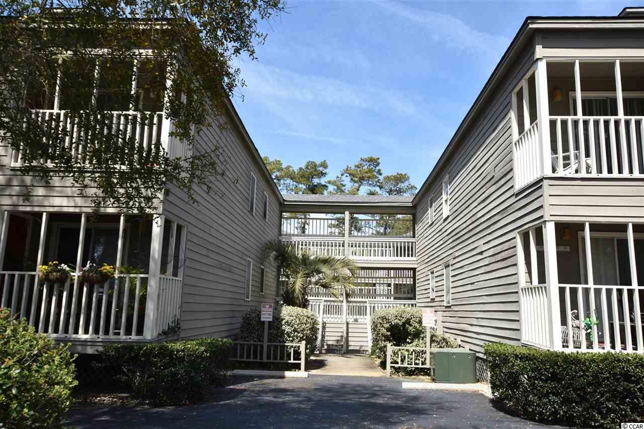 One of the best kept Secrets in North Myrtle Beach! Only two blocks off the ocean and one block from Main Street but hidden away between mature trees. Ocean Winds sits by itself at the end of Toby Court, so there is no traffic and even some locals won't know its back there! This charming 2 bed, 2 bathroom unit is on the second floor, and boasts beautiful views of a pond and the stunning mature trees all around the complex. The kitchen was upgraded with stainless steel appliances and back splash. There are wood floors running through the whole property. It comes mainly furnished, please ask for the conveyance list. The built-in in the living room alone bring tons of storage. Owners are allowed golf carts, spaces are assigned and do not convey with the unit. There is a waiting list. Come see this beautiful unit today, don't miss your chance!  Square footage is approximate and not guaranteed.  Buyer is responsible for verification.
