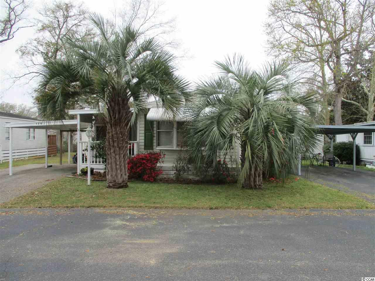 2BR 2BA lakefront home in Inlet Oaks Village, a 55 and older retirement community in Murrells Inlet, SC, approx. 12 miles south of Myrtle Beach. Community has a clubhouse & pool for residents and their guests, plus lots of activities for residents who wish to participate. Community also has 3 lakes for fishing or just enjoying the birds and wildlife, plus a secure storage area for residents to keep boats, trailers, etc. Inlet Oaks Village is near Murrells Inlet's famous waterfront restaurants, close to shopping, entertainment, great golfing, a modern hospital & doctors, and only minutes away from Huntington  Beach (ocean front) State Park. Also minutes away from Brookgreen Gardens. This is a spacious home with lots of upgrades. It has a sun room in back that overlooks the lake at your back yard, an 8x20 addition to the living room, a large walk in closet and storage room addition, remodeled kitchen, walk-in shower in master bath, a new rubber roof in 2015, a car port, and a covered front entry porch. New a/c &heating system in 2014. Also has a large site built storage building. This is a solid home in a great location, it won't last long call today for an appointment to see.