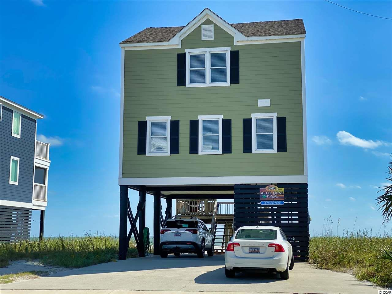 645 South Waccamaw Drive (After Dune Delight) is a four bedroom, three bath ocean front beach house, located in Garden City Beach, SC.  This home is newly renovated, featuring crisp new kitchen, bathrooms, flooring, lighting and more.  Enjoy beautiful views, bright, natural light and ample space to enjoy your time at the beach.  If the temperature is a bit chilly, hop in the hot tub and enjoy!  The back deck is being updated, so be on the lookout for new photos.  To see more of this wonderful property, check out the walking video tour on my YouTube channel.