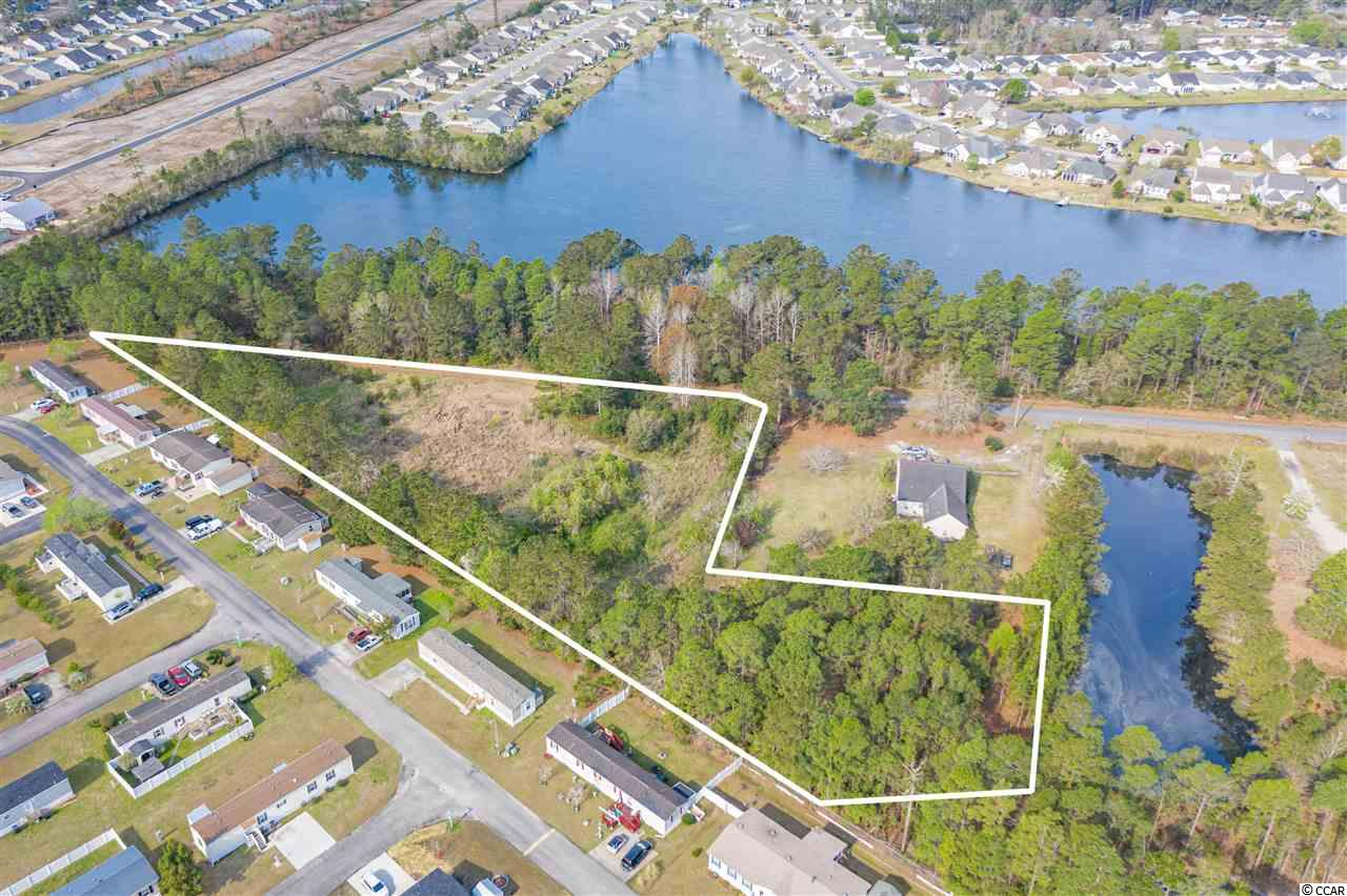 Build your dream home on this 3 acre lot in a great location off HWY 90. Not in  flood Zone. Less than a mile away from 501, close to major highways 31 & 22 and historic downtown Conway! Many great options for shopping, dining and short ride to the beach! NO HOA.