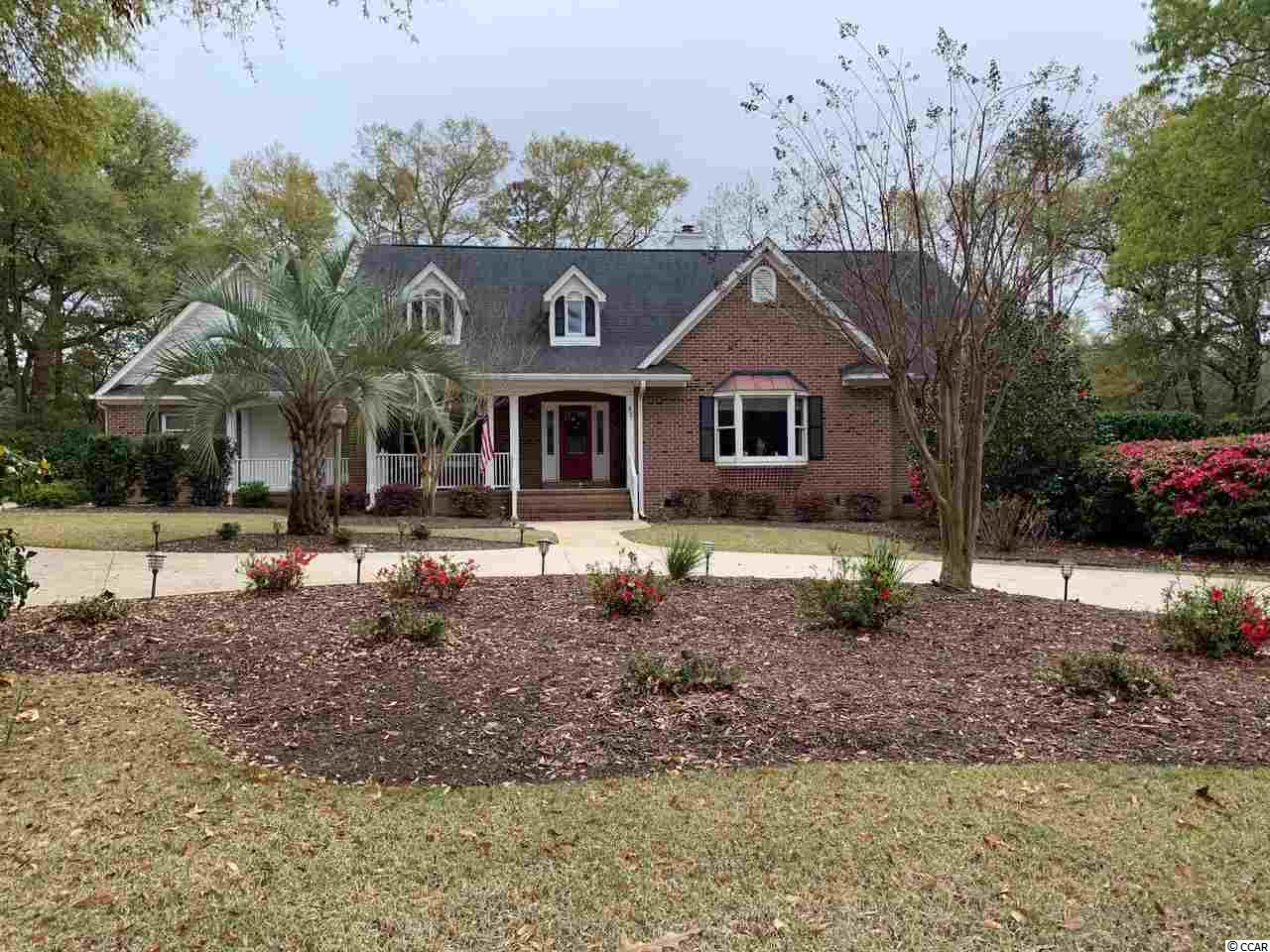 This spacious brick home is located on a quiet cul-de-sac in desirable & gated Willbrook Plantation.  This beautifully landscaped home has 4 bedrooms and 3.5 bathrooms with a separate study/office and large bonus room.  Situated on the 15th fairway of the Willbrook Plantation golf course, the outdoor porches are a wonderful place to enjoy morning coffee or an afternoon drink and watch the golfers go by!  The living spaces in this home are endless...a den that includes a gas fireplace, a huge Carolina/sunroom with a wet bar and beverage refrigerator that connects to a sun/screened porch are all on the first level. The large first floor master suite has a large walk in closet and gracious master bathroom with newly painted and updated cabinets.  The second floor has two bedrooms, a bathroom and contains a cozy den that includes a small kitchenette and separately controlled HVAC.  There is a second back stairway from the garage for privacy to the upstairs living quarters.  Perfect for a family with multi-generational living.  The kitchen boasts of granite countertops, stainless steel appliances, custom cabinets, a kitchen island with butcher block and a walk in pantry.  42 Warnock Way also features a dining room, breakfast room, home office, a 3 car garage and lots of storage space!  Willbrook Plantation offers a clubhouse and pool and access to Litchfield by the Sea amenities including the private beach!  Pawleys Island is located just a 70 mile drive for a day trip to historic Charleston, SC or 25 miles to the attractions of Myrtle Beach.