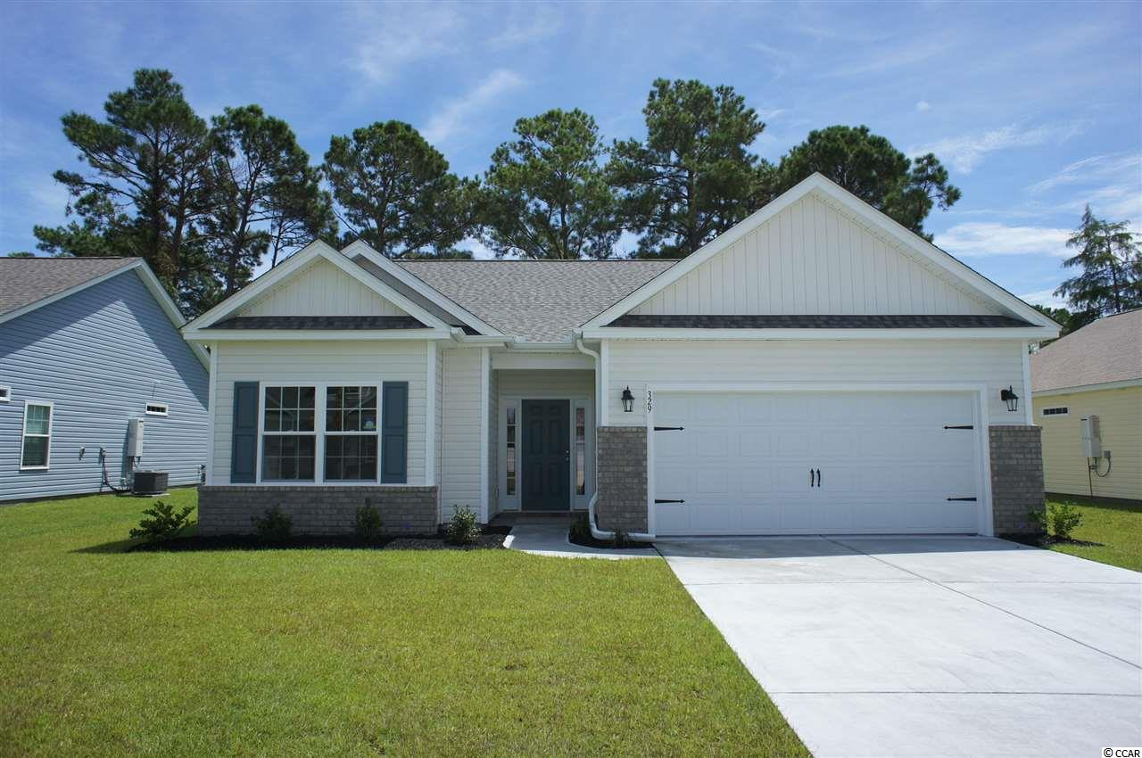 Beautiful Hatteras floor plan in the new Ocean Palms community. This terrific open floor plan, 3 bedroom, 2 full bath home will have wood-look vinyl flooring in the family room, kitchen and dining area, under the soaring vaulted ceiling, and comfortable carpet in the bedrooms. Stainless appliances, staggered-height stained birch cabinetry and a convenient and beautiful granite breakfast bar combine to give you the wow factor you're looking for, and abundant recessed lighting plus two large windows in the adjacent dining area flood the room with light. A French door in the great room leads to the screened rear porch and the large separate patio beyond. The spacious master retreat features a long vanity, an oversized walk-in shower, plenty of storage in the linen closet and a huge walk-in closet, plus a tray ceiling. Two additional bedrooms and a full bath are tucked off on their own hallway, for privacy. All of the homes in Ocean Palms come standard with the luxury of natural gas (tankless water heater, gas heat, and gas range). The two car garage is completely trimmed and painted, and a floored attic storage space is accessed by drop-down stairs. Ocean Palms is conveniently located near shopping, restaurants, schools and world class medical offices and hospitals, and only a short golf cart ride to Surfside Beach's gorgeous beach and the beautiful Atlantic Ocean. Other floor plans and inventory homes may be available, and CUSTOMIZATION OF FLOOR PLANS IS POSSIBLE!!! Community Pool and Cabana Coming Soon! Photos are of a completed, similar home and may have different features.