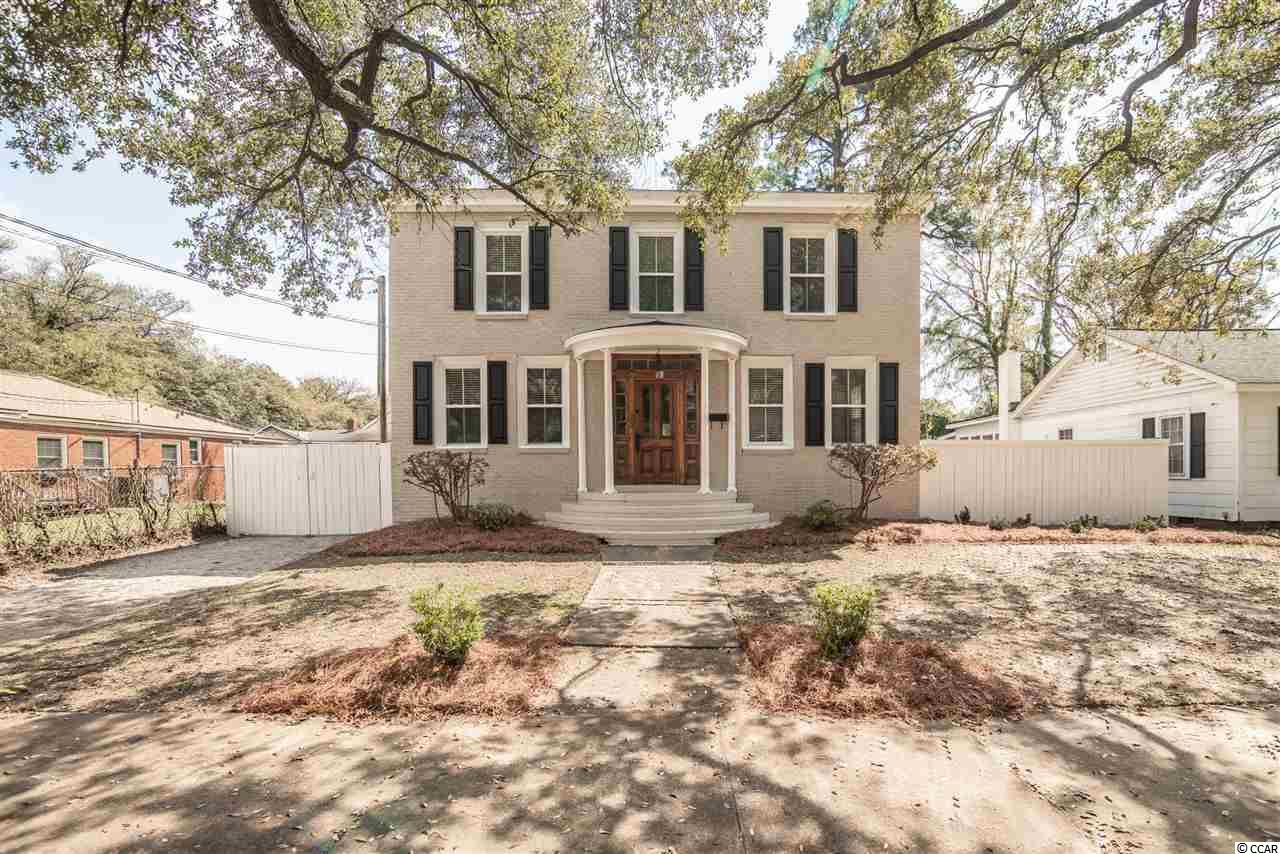 Historic downtown Georgetown colonial home on live oak lined street and high lot location. This recently remodeled home is just steps from the waterfront  and offers fenced yard and detached garage. Great room at the entrance with first floor optional bedroom or home office and half bath. Kitchen with granite counters and stainless appliances overlooks backyard. Upstairs master with en suite bath and walk in closet as well as two additional guest rooms and a hall bath. City sidewalks, parks, dining, shopping, and watersports await.