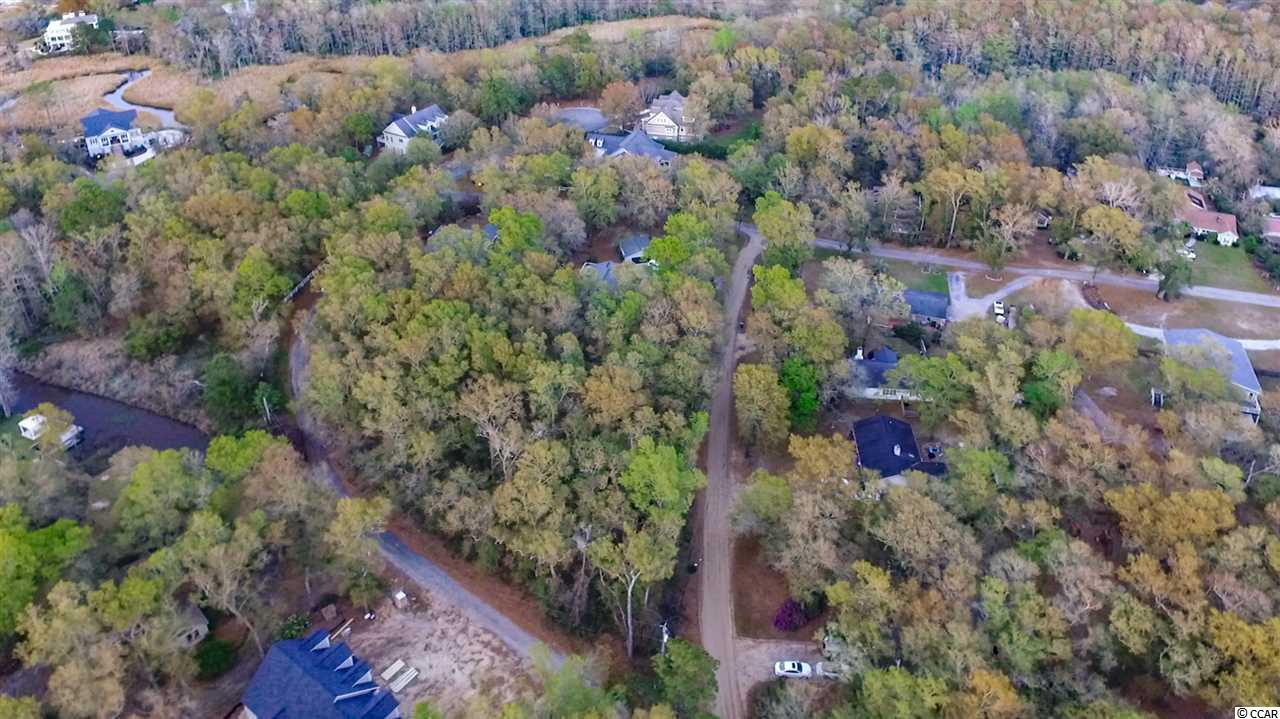 Great affordable lot in Hagley Estates!  Within walking distance to the Hagley public boat landing, walk or bike or golf cart to the Waccamaw River and enjoy amazing sunsets or take a boat and launch into the river and cruise on down to the ocean for relaxing day.  This is an optional HOA neighborhood but has the benefit of the discounted cable and internet.  Park your boat and R/V in your own yard.  No time frame, build at your own pace. The Pawleys Island beaches are close by in this coastal town as well as everything else this unique lifestyle has to offer!