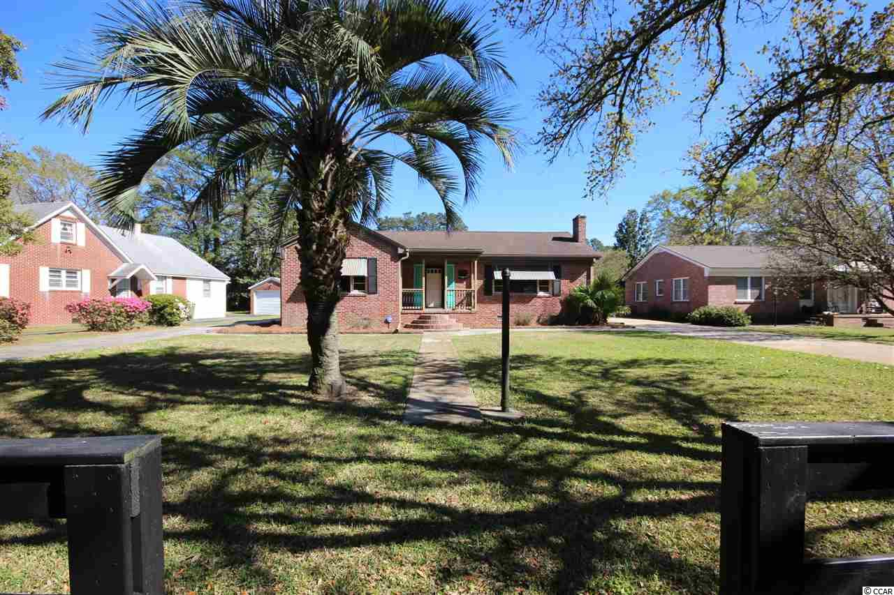 Lovely Move-In Ready ~ All Brick ~ 3 Bedroom, 2 Bath Home situated on Quiet Live Oak Lined Street. Conveniently located to both the Georgetown Memorial Hospital and the Historic Downtown Area, the Home is positioned on a Large, Neatly Manicured Lot offering both a 2 Car Detached Garage and a 1 Car Detached Garage with a Circular Drive providing additional Parking. The Home Boasts of Stainless-Steel Appliances, an Efficient Geo-Thermal Heating and Cooling System, Attractive Fireplace with Hardwood Flooring on All One Level. Additionally, the Short Drive to Myrtle Beach to the North and Charleston to the South ~ makes this one Very Exceptional Home! Please feel free to call and schedule a personal Virtual Tour of this Lovely Home.