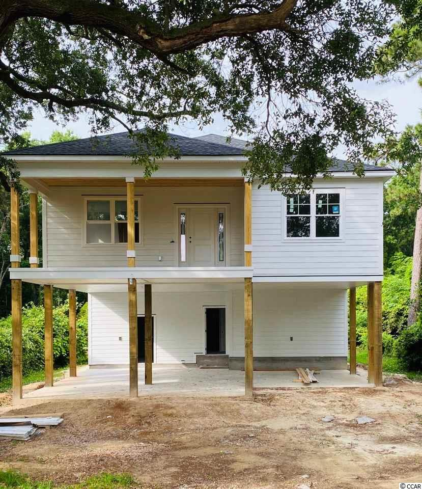 This is the one you have been waiting for! Under Construction Raised Beach House.  Beautiful setting with a majestic live oak in a marsh view community! No HOA. Double Back Porches. Storage galore for all your beach and river toys.  Bike and Golf Cart to the beaches of South Litchfield. Impressive Features include Premium Hardie Siding, Granite Counter Tops, Tiled Kitchen Back splash, Hardwood Flooring, Tiled Master Shower and much more.