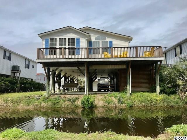 "Truly a One-of-a-Kind home located on the canal, in the Keys Section of Oceanside Village. Oceanside Village is a family friendly beach front  golf cart community. This home is 28x52 Modular home and conventional financing is available.  There is no better home for you to fill that ""wish list"" of must haves. Come and stay for a few weeks each year while reaping the benefits of the income based on established rental history or stay for a lifetime of happiness – the possibilities are too numerous to list.  Featuring 3 over sized bedrooms, 2 baths. Granite counter tops, custom tiled shower, and lots of windows for natural sunlight, built in stereo, and message system. The master features a walk in closet, vaulted ceilings, and private en suite. Outdoor shower, swings, tons of covered parking & outdoor decking for sunsets, tropical drinks and ocean breezes.  Don't let this opportunity to own in one of the most sought after residential resort neighborhoods on the South Strand slip by.  Private Beach Parking"