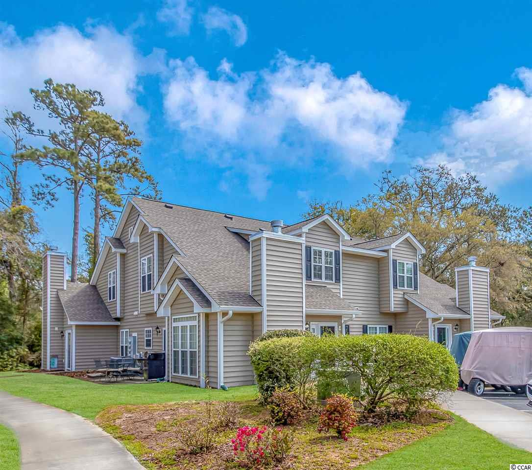 Wonderfully decorated turn key end unit 3 bedroom 2 bath townhome in an excellent location in North Myrtle Beach.  This unit has new paint, flooring and dishwasher.  The property is walking or golf cart distance to the beach and restaurants on Sea Mountain Highway.  The home is in a quiet cul-de-sac located close to the pool, clubhouse and play area.  Golf carts are allowed to be kept in the parking lot.  Come see this beautiful unit today before it's too late.