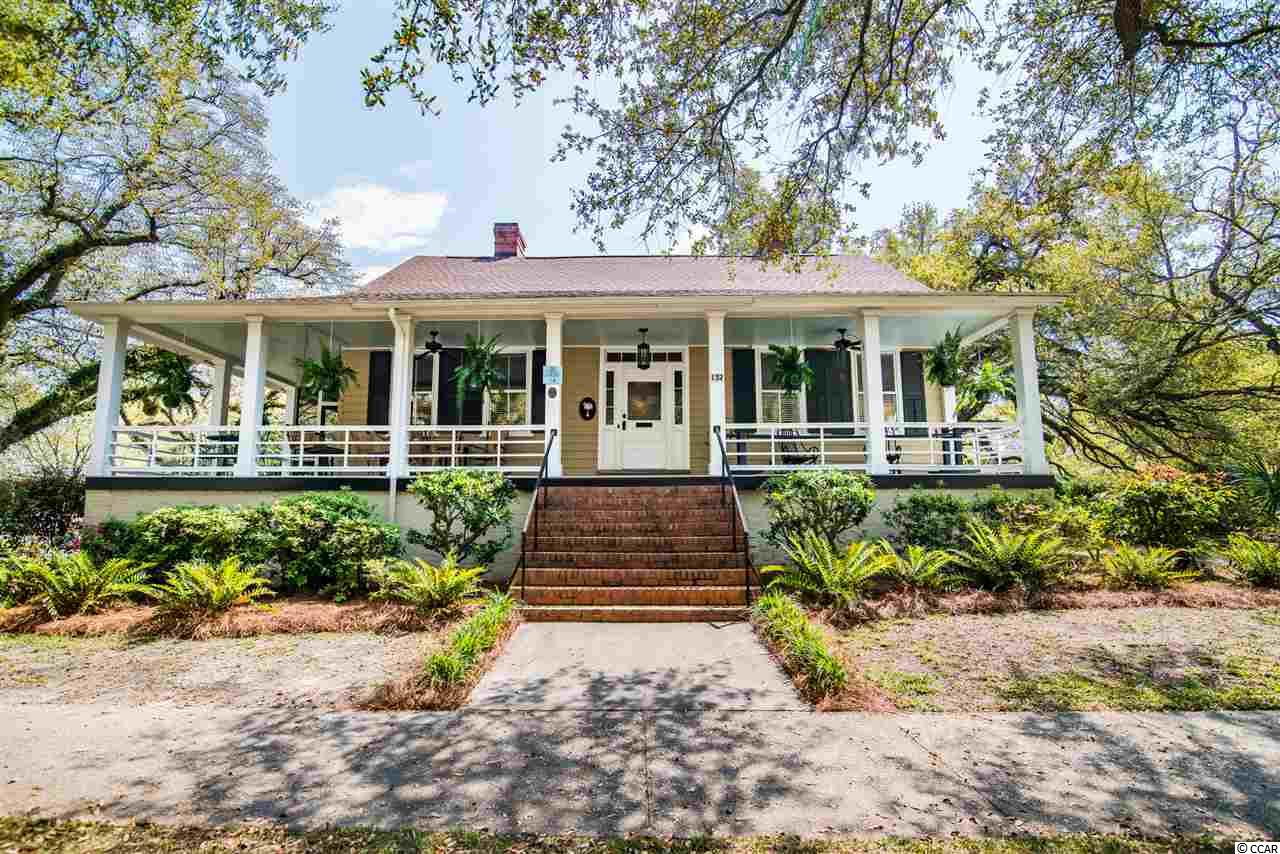 Incredible renovation of a historic 1830's low country home on a very stately corner in downtown historic Georgetown. Once entering the home through a large center hallway, you will immediately recognize the beauty of the tall ceilings, crown molding,  gorgeous hardwood floors and the multiple fireplaces. Large formal areas as well as casual living areas with new kitchen and bathrooms. In the kitchen, you will find original bead board as well as an original exposed beam from 1830. Granite countertops and breakfast bar and dining area complete this wonderful renovation. Lovely master bedroom with a sitting room or home office space. This home features a wrap around front porch as well as a screened area for your outdoor enjoyment. Beautiful landscaped yard completes this perfect family home. Truly a gem that must be seen to appreciate the history and beauty of this very special home. Renovations include the updating of all the wiring, plumbing, duct work and HVAC for the upstairs bedrooms as well as new roof and tankless hot water heater. New gas heater in 2020.The Kirton-Hamilton house is a good example of a modest Greek Revival cottage with its gracefully simplicity and well proportioned rooms and broad piazzas.