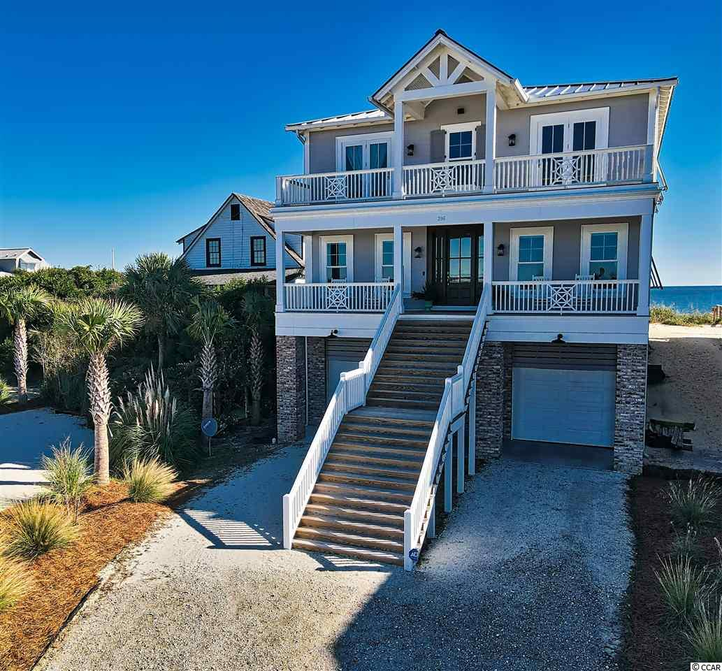Enjoy luxury Oceanfront and Creekfront living at its finest on beautiful Pawleys Island Beach!   Located just across from the famous Pawleys Island Chapel, this oceanfront and creekfront home with dock boasts of amazing views.  Enjoy an amazing sunrise on ocean side porch and the spectacular sunset on the creek side porch.  Custom Built and designed by local design builder David Lane in 2019, this home is the perfect place to relax with family and friends.  Plenty of space for everyone with 6 bedrooms and 6.5 bathrooms and an elevator.  No expenses were spared!  This lovely home enjoys all the character and charm of a classic Pawleys Island home while still including all of a new home's modern luxuries. The gourmet kitchen has quartz countertops, custom cabinets, high end Thermador appliances and a spacious pantry with a classic Pawleys style screen door.  The downstairs has two full bedrooms, each with their own bathroom, shiplap walls and beautiful random width white oak floors throughout.  The cozy family room has a gas fireplace and wet bar, the perfect place for sitting and enjoying the beautiful beach views.  Each floor has its own laundry room.  The top floor has 4 bedrooms with their own private bathrooms, laundry room and an additional living room/den.  Plenty of porch and deck space to enjoy outdoor living!  Close to shopping and some of the SC Coast's most highly acclaimed fine dining. Pawleys Island is located just 65 miles from Charleston, SC or 25 miles to the attractions of Myrtle Beach.