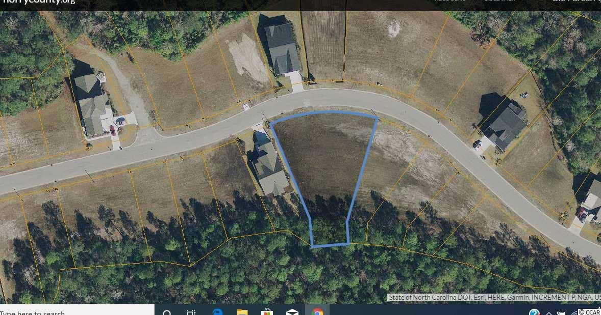 Wonderful OPPORTUNITY to own a DOUBLE LOT in the prestigious Carolina Forest Community of Waterbridge. This home site is just over 1/2 acre, totally cleared and ready for your custom house! No time frame to build, bring your own builder, only pay 1 HOA payment and enjoy the privacy of backing up to a NATURAL PRESERVE! Waterbrige amenites are second to none and feature a resort style pool with swim-up bar, fitness center, clubhouse, tennis courts, basketball court, mature landscaping , community boat launch and boat storage just to name a few! Located only 10 minutes from the beautiful Atlantic Ocean! Near all the best shopping, dining, attractions, night-life , schools and championship golf! Come envision your low-counrty, laid back future today!