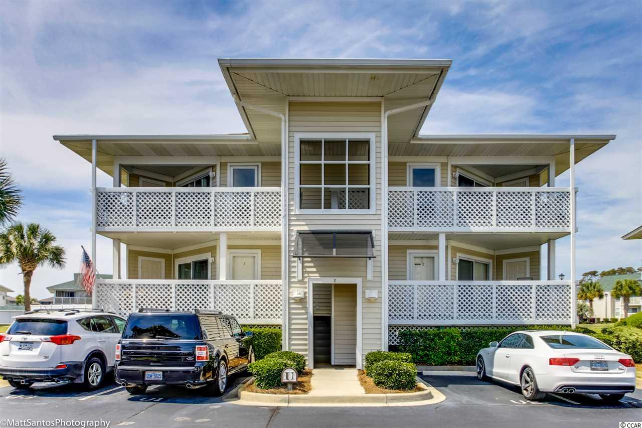 Nicely maintained 2BR/2BA second floor condo in Shorehaven, across Ocean Blvd from the beach in Cherry Grove.  This condo has Coretec luxury vinyl plank flooring in living/dining/kitchen, carpet in bedrooms, and tile in bathrooms.  Granite counters in kitchen, refinished cabinets, stainless refrigerator and dishwasher.  New hot water heater in 2015, new HVAC system in 2016, roof about 10 years old, Pool and pool deck recently resurfaced.  Sold unfurnished but sofa/love seat and dining set will remain if interested.  Condo has a nice view of the lake across the street from the front porch and a peak at the ocean from the back porch