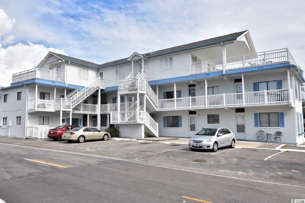 Are you looking for that little piece of North Myrtle Beach paradise?  Well here is a chance to obtain that!  This 2 bedrooms one bath unit is located right across the street from the public beach access at 15th Ave. South.  The unit comes fully furnished with a nice kitchen area which includes a refrigerator, microwave, stove, dishwasher, and a breakfast bar.  The living room is spacious with tile floors and the bedrooms have luxury vinyl floors. Both bedrooms have closets for your convenience.  The bedrooms and the living room have ceiling fans and there is a Carrier heat/air conditioner unit in the living room.  This unit also has a Rudd propane gas tankless water heater.  This is a first-floor unit so it has easy and quick access to the beach along with all of the area attractions.  The HOA fees are lower than other similar properties nearby.  The building recently had the roof replaced and it's ready for you and your family to come and enjoy the beach lifestyle!  The unit can serve as a short term, long term rental or a permanent residence.  This is a low-cost low maintenance condominium and right across the street to the beach. The entire exterior of building- including shutters, doors, walkways and railings, has a fresh coat of paint(Oct. 2020).  So why wait for something more expensive when you can be here for lower monthly expenditures!  Square footage is approximate and not guaranteed. Buyer is responsible for verification.