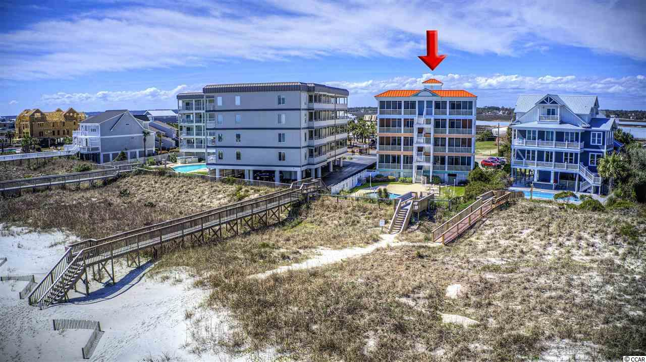 It's been nearly 2 years since one of these desired units has hit the market!! Quiet, quaint, spacious, and unique would describe this desired condo community the best! It's one of the few condo communities located on the south peninsula of Garden City Beach! There are only 8 total units with plenty of parking (16 spots). AND It's the only oceanfront condo building with access to the gated Inlet Pointe dock across the street (Perfect for those that enjoy fishing, crabbing, bird watching, or site seeing). Not only is this community itself extremely quiet, the beach is nice and peaceful too! Features such as the large protected dunes, wide beaches, quiet south peninsula atmosphere, great parking, and dock access; makes Compass Rose one of the most desired condo communities along the South Strand! The unit features like the large screened in porch, rear access to the beach, personal storage room under the building, separate laundry room, and spacious layout sets this unit apart from the others you'll see along the Grand Strand. The building itself was completely renovated in 2004 and included moving the elevator to the ground floor for easiest access. The most recent building updates include new pool, crosswalk, and resurfacing of the deck. The owners of #22 have also done many recent updates themselves. A few highlights: (2019) New LVP flooring, subway tile back splash, dishwasher, and washer in laundry room. The owners also recently upgraded to solid wooden doors throughout, a walk-in shower, & HVAC handler & condenser.