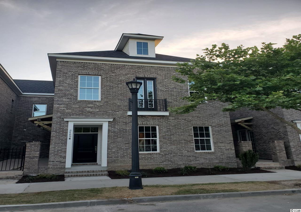 This uniquely designed townhome features a brick courtyard with gas hookup for a grill.    French doors and window to courtyard provide light, so this unit has sunlight on 3 sides!   Other features include an open floorplan with granite countertops, engineered hardwood floors through the first floor, an office, 3 large bedrooms, an oversized 2 car garage and more!