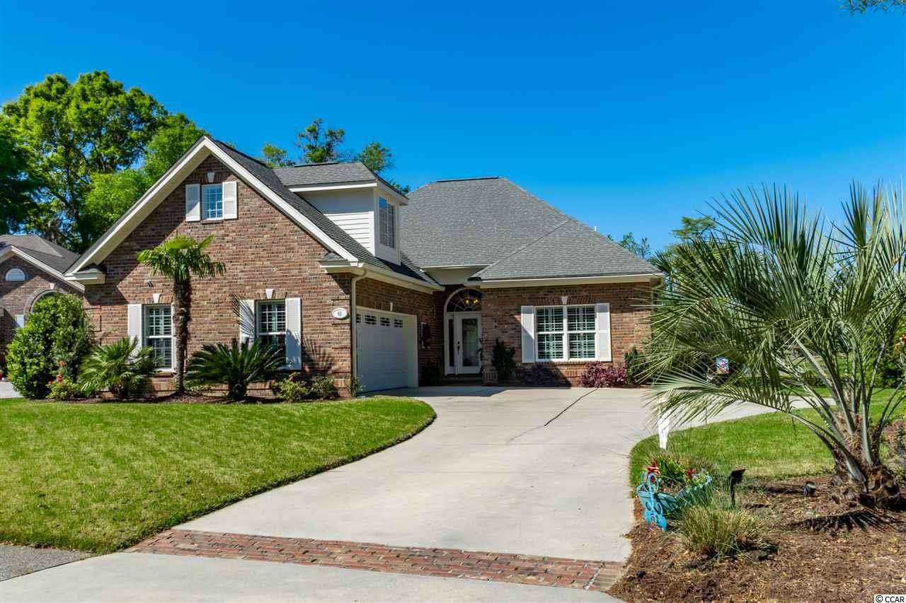 "Fantastic opportunity to live in one of the most popular gated communities in Pawleys Island. You will be hard pressed to find an upgraded home with a view like this anywhere in Pawleys Island at this new price!  If you are an avid golfer or boater this community is made for you! The 4 bedroom 3 bath all brick, single level home, sits on one of the MOST COVETED view lots in all of Heritage Plantation. Overlooking a huge natural fresh water lake, the 13th island green and several more holes of the golf course, this is a view you can never tire of. Enjoy it from the family room that adjoins the kitchen, The brick patio off the family room or the Heated/Cooled 4 season screen porch off the master suite!  The owners have spared no expense is upgrading this home over the years. Features such as new HVAC ,vent free gas logs in the fireplace, new lighting and ceiling fans throughout, new granite and back splash in the kitchen, New stainless Refrigerator to match existing stainless appliances which includes a propane gas cook top, high impact- tinted windows, new interior paint, Plantation Shutters throughout, new sun filtering shades installed in the family room and 4 Season porch,  the list goes on and on! The master suite boasts 11 ft tall ceilings and is located at the back of the home. It also features a large master bath with dual sinks, jetted tub, tiled walk-in shower, and his/hers walk in closets. Two guest rooms are located on the opposite side of the house for maximum privacy. The huge 4th bedroom, or multi purpose room is located above the garage and is over 350 sf and includes a full bath. It's an ideal location for guests and grandchildren!   The amenities found in Heritage Plantation are the best around. Your reasonable HOA dues entitle you  to an amazing Owners-only Clubhouse with card room, kitchen,conference room, 75 ft. heated swimming pool,(even in the off season), Lighted  Har-tru tennis courts, 24 hour security with gate guarded entry, a 40 slip Marina on the ICW with a full time Dockmaster. (Boat slips and storage are also available at an extra cost.) You'll find an amazing ""Party Deck"" at the Marina where homeowners gather regularly to enjoy a glass of wine and the most amazing sunsets around! On site management and full time maintenance are also included in your HOA dues.  For the golfers out there Heritage Golf Club is ranked among the ""50 Best Public Courses in America"" by Golf Digest. Very reasonable memberships are available (but not required) which makes this golf course one of the top values in the area.  Heritage is located only 70 miles or so from Charleston, the ""foodie"" capital of South Carolina. Just up the road is Myrtle Beach with all of it's attractions. Enjoy the hustle bustle up there, then return to the serenity of a true Low Country lifestyle within Heritage Plantation. Have I whetted your appetite to know more about this amazing property? Just call me, or your Realtor to arrange your private showing."