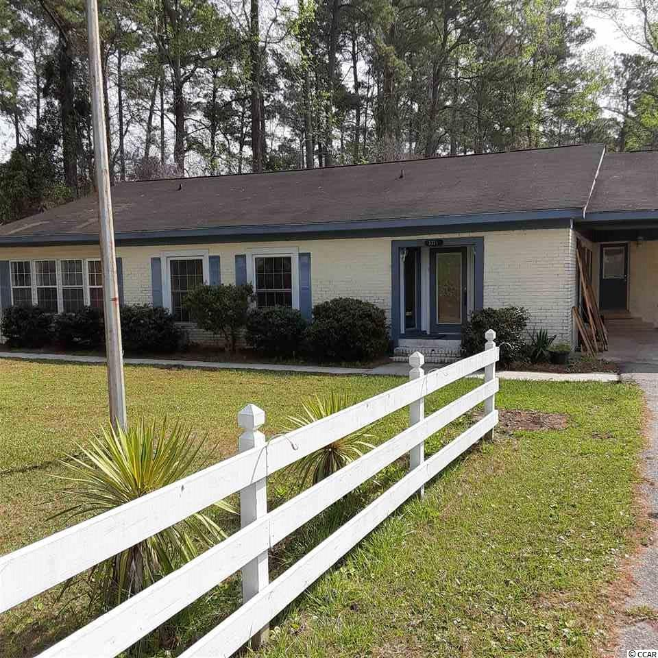 Updates ranch home, all on one floor with .5 acres of land. Large kitchen (updated) and living room (gas fireplace), fenced in yard, attached carport, located in Little River, close to 2 golf courses (within 1.5 miles). Home is close to Highway 31 (few miles) which can take you anywhere in Myrtle Beach you want to go. A quick ride to the beach as well.
