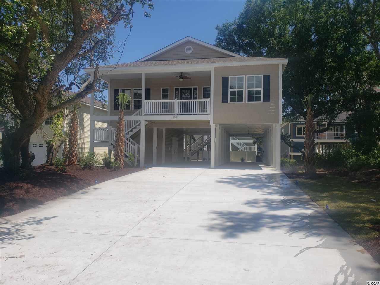 4BR / 3BA new construction raised beach home 2 blocks from the ocean in the Crescent Beach section of NMB. - Home feature s: 9 & 10' ceilings, crown molding, granite countertops in kitchen and baths, tile shower and double vanity in master, full appliance package, concrete drive and fully landscaped yard.