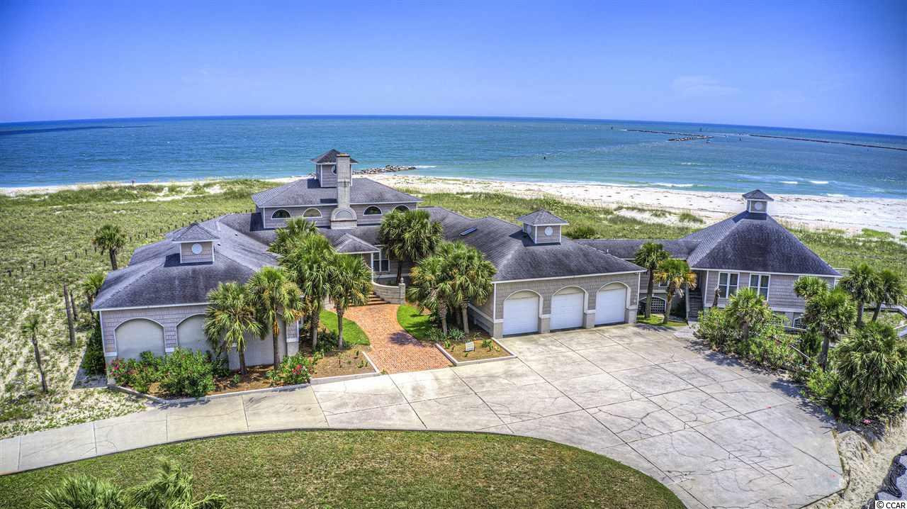 One of a kind. Spectacular views. Truly unique for this area. These are but a few of the attributes offered to 2273 S. Waccamaw Drive, situated on a waterfront bluff. This sprawling home is regally positioned on the tip of the Garden City peninsula, sheltered within Inlet Harbour. It sits on nearly an acre and a half that looks out to the ocean and Murrells Inlet jetties, overlooking the tip of Huntington State Park. Views seem endless. Hours can be lost on the expansive back porch. Featuring five bedrooms, six bathrooms, a large dining room, a grand family space, a spacious office, a large craft room, and many additional spaces. Almost every single window in this spacious home has a beautiful water view. The home is in need of some TLC, but the 6060 square foot space is amazing. You may view a walking video tour of this property on my YouTube channel.