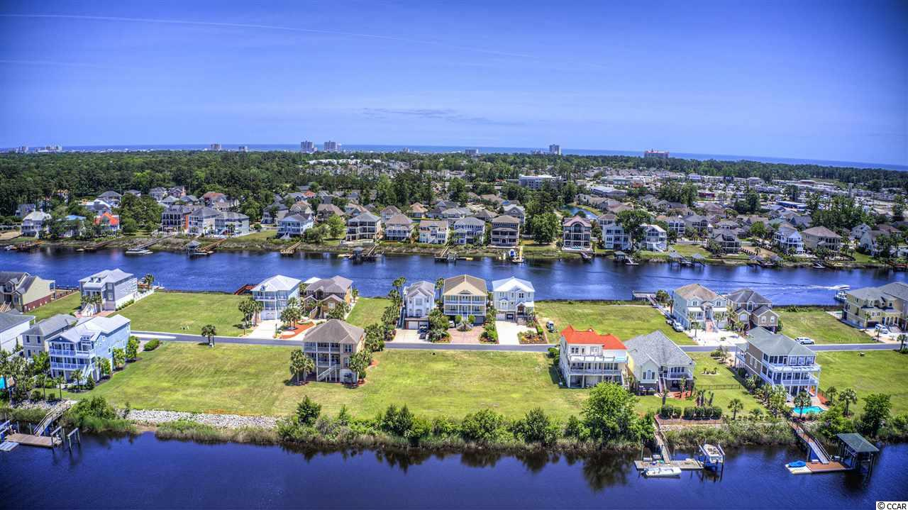 Build your dream home in the prestigious,  gated  Waterway community of Paradise Island. This waterfront lot is on the Channel to the waterway, has deep water to allow big boat access! Don't miss out on your chance to live on the island with the elite and enjoy the Waterway Life! Dredging fee has been paid in full!
