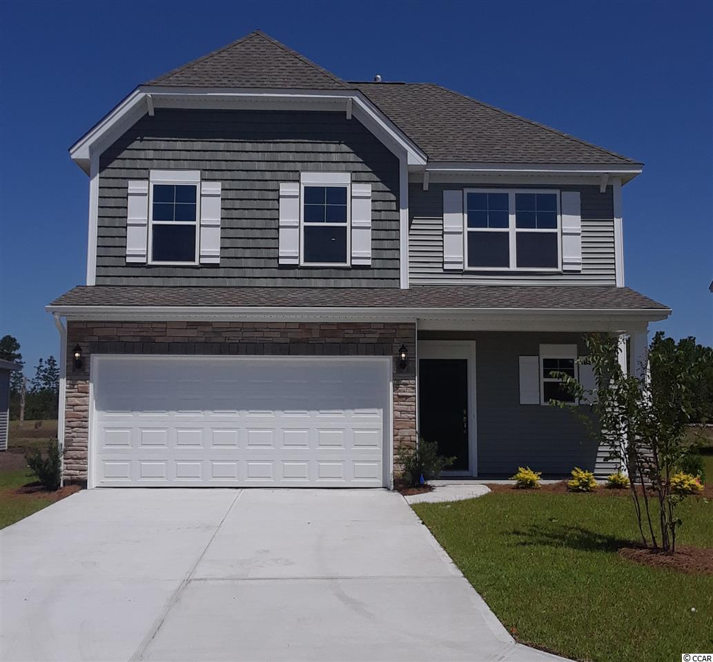 Ready in July. Ask about Flex $$ incentives. Model Home open every day! Mon-Tues 11-5, Wed 1-5, Thurs-Sat 11-5 & Sunday 1-5. Two-story home with 4 bedrooms and has 2.5 Baths. This Vernon plan has Super Spacious bedrooms with the Master Suite on the main level and the 3 others are upstairs.  3 of the guest bedrooms are as large as the master and have walk-in closets. From the front door, Luxury Vinyl Plank leads through the arched entry way leads into the dining room and into the open kitchen and great room. The kitchen features stainless steel gas range, dishwasher and microwave.pantry and a raised bar for entertaining. White shaker, enamel cabinets with Gorgeous  Quartz counter tops. The large master suite with tray ceiling is located on the main level and features a spacious Tile Separate Tub and Shower, walk-in closet, water closet, raised vanity with quartz tops, framed mirror and center bank of drawers & linen closets. This home is complete with a large first floor laundry and powder room. Family room walks out to light filled sunroom for relaxing and fencing across roomy back yard. Additionally, we include an irrigation system to keep your yard looking good. You can enjoy all of the our award winning hauSmart standard features like: the enhanced appliances and kitchen cabinetry with varied heights & large crown molding, and, others such as the Radiant Barrier Roof Sheathing, a Lennox HVAC system designed and tested by an independent 3rd party, R-38 attic insulation, and a Rinnai tankless hot water heater that you'll appreciate when you receive your monthly power bill. And because it's hauSmart, the home is healthier for you and the environment. Clear Pond at Myrtle Beach National in Carolina Forest of Myrtle Beach is a natural gas community and has resort style amenities featuring a large fitness center, a beautiful club house and two pools. Pictures of this Vernon are from another Vernon home in the neighborhood. See sales representative for specific details.