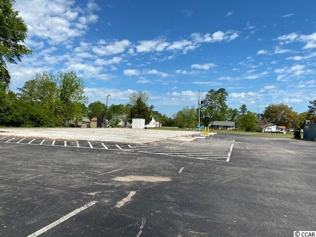 This commercial lot in Downtown Hemingway is ready for it's next business!  There was a grocery store in this location which competed well with Food Lion and location is perfect for a small grocer, thrift store or fast food chain.  Corner lot with lot behind it included in the sale price.  Over 2 Acres in total.