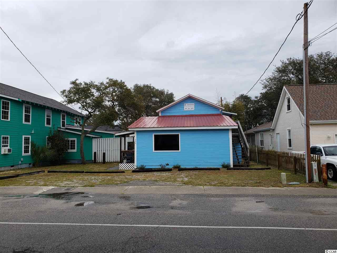 3 units total built on a commercial zoned lot, a block from the ocean in NMB. The property offers two 1 BR / 1 bath units and one 4 BR / 2 baths unit. 508 & 510 17th Ave S. are also for sale.