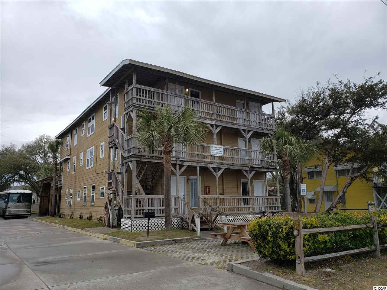 Nine units for sale at the heart of North Myrtle Beach, just 1 block from S. Ocean Blvd. and 1 block from the hub of shops and attractions on Main St.  Walk to the ocean/beach and then walk to all of the fun activities.  ou won't have to worry about finding a parking spot.  all units are up to building codes.  There are three 1 bedroom, 1 bath units, two 2 bedroom, 1 bath units, and four 2 bedroom, 2 bath units.  This property is be sold as a package with a second listing for an adjoining property at 211 1st Ave S. The owner reserves the right to refuse to sell this property separate from the other listing.  ENTRY TO THE INTERIOR IS NOT AUTHORIZED!
