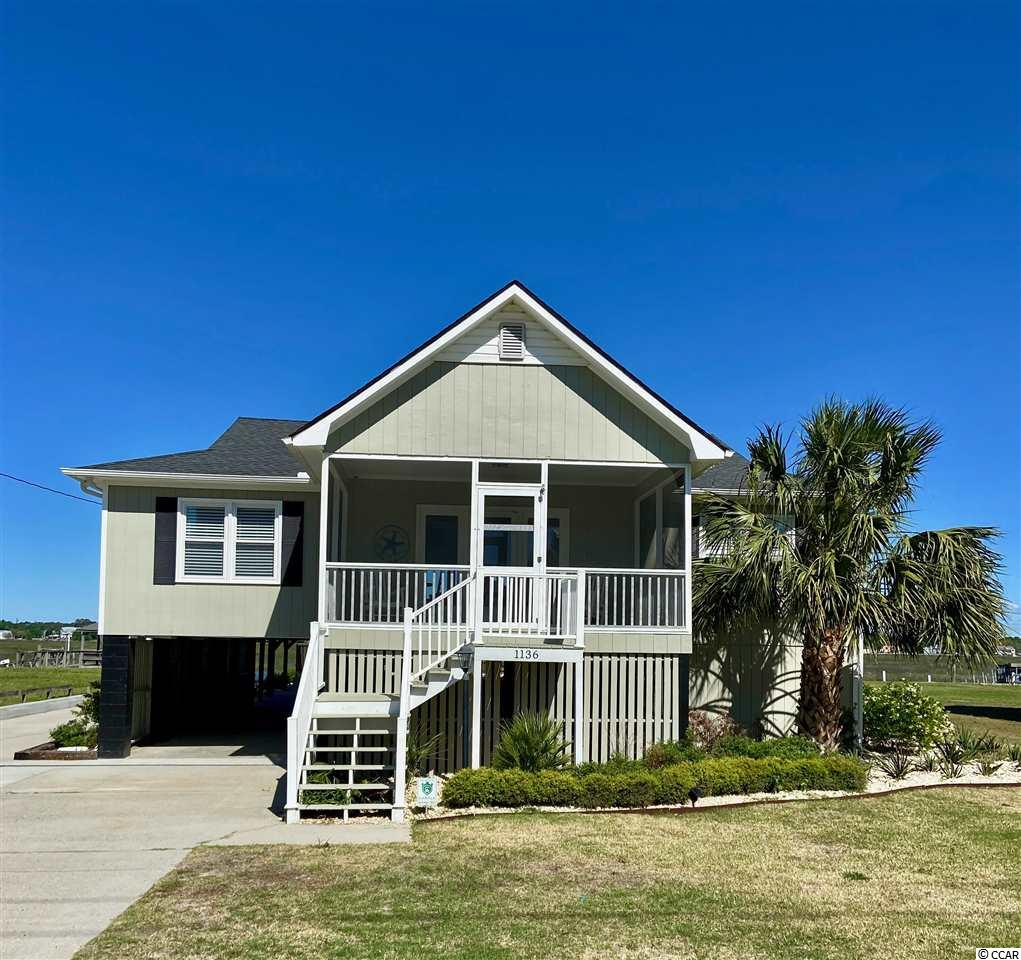 Everything you have been waiting for!  Creek front, deepwater, fixed & floating dock, 16,000lb boat lift, private boat ramp, pool, beach access across street, 6 bedrooms...Incredible Sunsets, flir security cameras!  large 75x220ft lot. Boat to the Marshwalk for dinner, access to the ocean....there is too much to list.  Call for a private showing.