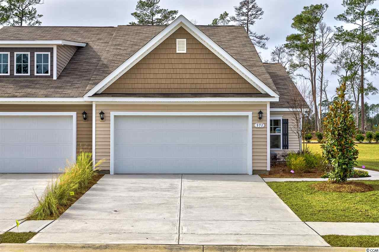 """Lovely, low maintenance, paired ranch home in a brand new community! This Tuscan floorplan offers a spacious, open layout all on a single level. With vaulted ceilings, tons of natural light throughout the living and dining areas, large kitchen island, and spacious covered patio, this home is perfect for entertaining! The kitchen also features granite countertops, stainless steel appliances, 36"""" staggered cabinets, and large pantry with ample storage. Roomy master suite with walk-in closet and private bath with dual vanity and 5' walk-in shower. This home also features laminate flooring in the main living areas, a tankless water heater, and our Home Is Connected smart home package. Yard and exterior maintenance are all covered! 4' black aluminum fencing is permitted (per HOA approval). *Photos are of a similar Tuscan home.  (Home and community information, including pricing, included features, terms, availability and amenities, are subject to change prior to sale at any time without notice or obligation. Square footages are approximate. Pictures, photographs, colors, features, and sizes are for illustration purposes only and will vary from the homes as built. Equal housing opportunity builder.)"""
