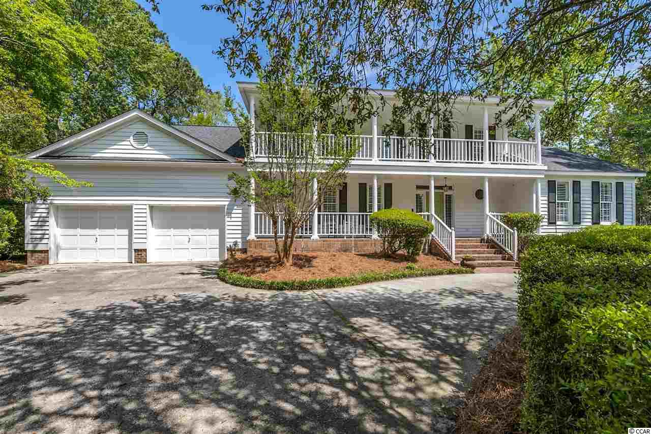 72-Hour Kick-Out Clause In Effect. Lovely and spacious Lowcountry-style home located on a quiet cul-de-sac in historic Wachesaw plantation. Heart pine floors welcome you into an entertaining open-plan space, anchored by a show-stopping fireplace that reaches into the cathedral ceiling, accented with pine beams. It leads into a well-appointed chef's kitchen, complete with roomy breakfast nook, commercial-style range, custom copper hood, granite countertops, and full walk-in pantry with refrigerator. The main-floor master suite includes a sitting room, double-sink vanity, two walk-in closets, a jetted tub, and separate shower. Also, on the main level is a roomy guest bedroom with an additional walk-in-closet and adjacent full bathroom. The main level is completed by a formal dining room, oversized laundry room, and a third full bathroom with direct access to the large screened-in porch, which faces the palm-flanked saltwater pool. (Go straight from the pool or the beach to the shower without getting a speck of sand in the house!) Upstairs you'll find the third and fourth bedrooms, a full bathroom, small office or hobby space, and two walk-in attics. Large glass double doors and tall windows throughout the home bring the outdoors inside in any season. The house is nestled on a secluded lake lot with mature growth, a circular driveway with parking for six, and a two-car garage with additional attached storage/workshop space. HOA amenities include staffed gated security, trash, and recycling pick-up, and basic cable and internet services. Wachesaw Plantation offers private club memberships complete with clubhouse and pro shop, Kimbels restaurant and Magnolia's snack bar, lighted clay tennis courts, pool, and a Tom Fazio-designed golf course. The home's location also offers nearby historical attractions such as Brookgreen Gardens, Huntington Beach State Park, Wacca Wache Marina and the Waccamaw River, Murrells Inlet Marsh Walk, and an 84-mile proximity to Charleston, Sout