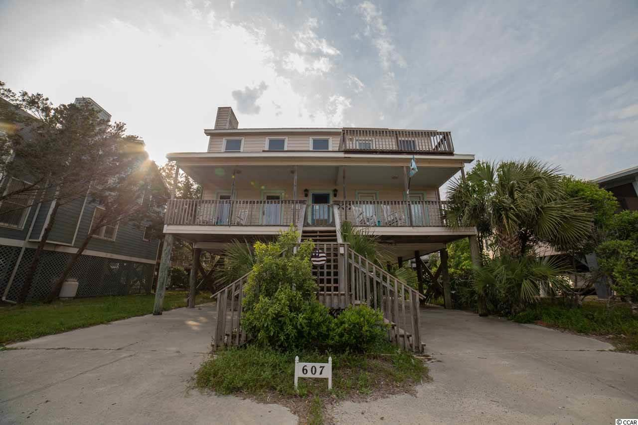 """Four bedroom three 1/2 bath raised beach home located on the south end of  Pawley's Island. This is a second row beach home with an ocean view. It is only steps away from a public beach access. This attractive and spacious two story beach home offers plenty of parking, a great front porch with ocean view, easily sleeps eight and it is near a public boat landing on the Pawley's creek. This home is being sold furnished with the exception of a few personal items. Start making your family  memories now on """"Arrogantly Shabby"""" Pawley's Island. Seller financing available for a qualified purchaser. Square footage is approximate and not guaranteed. Buyer is responsible for verification."""